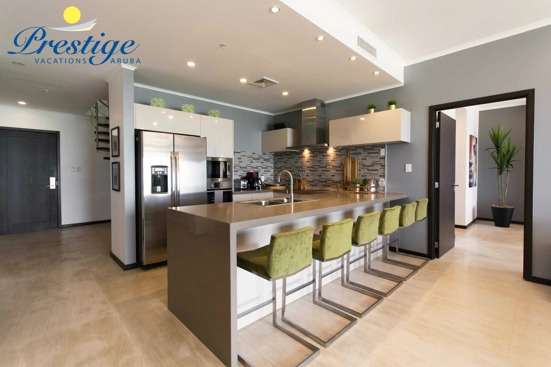 Fully equipped modern kitchen with 6-barstools