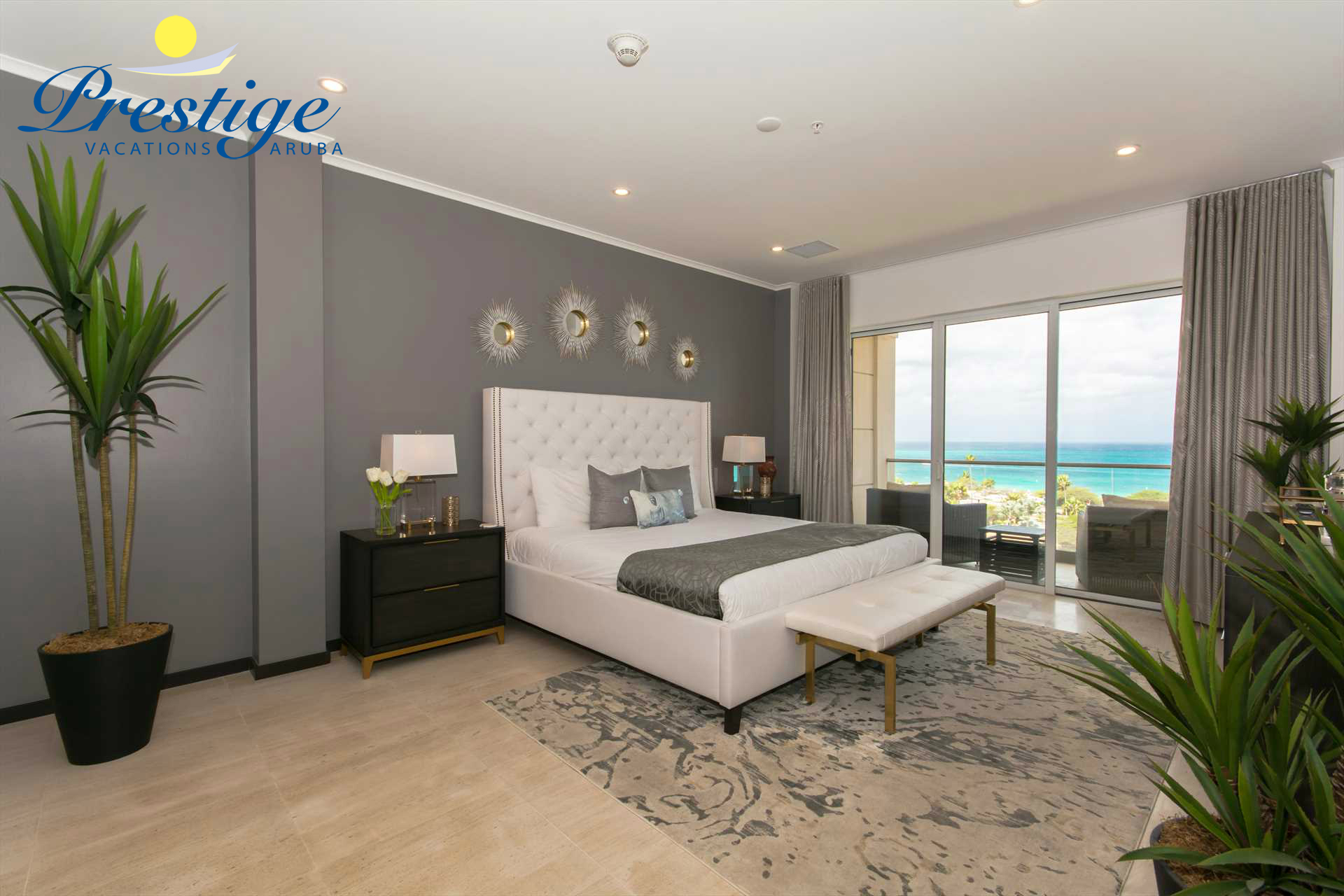 The master bedroom with king-size bed and access to the balcony