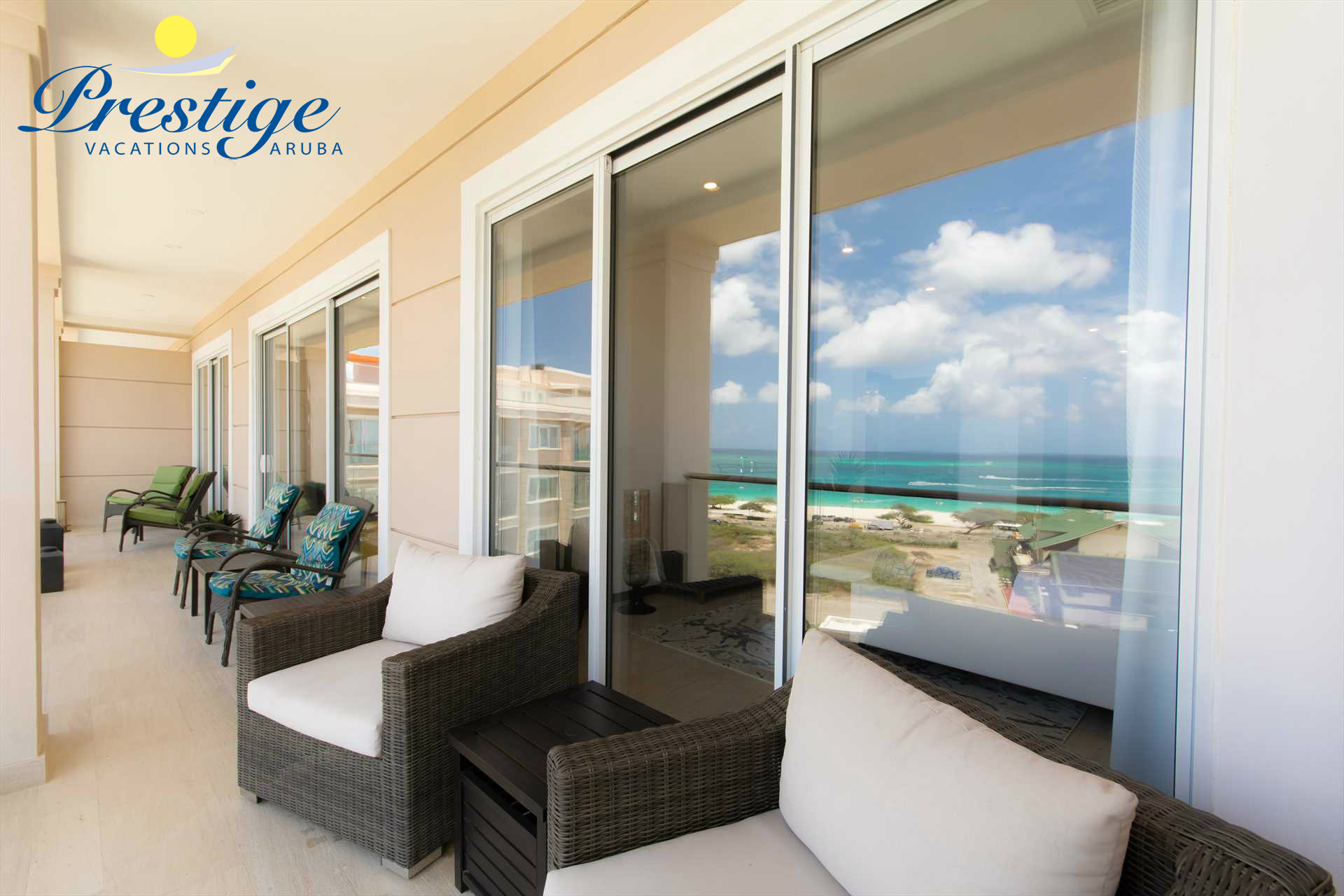 The balcony with several chairs to enjoy the picturesque beach view