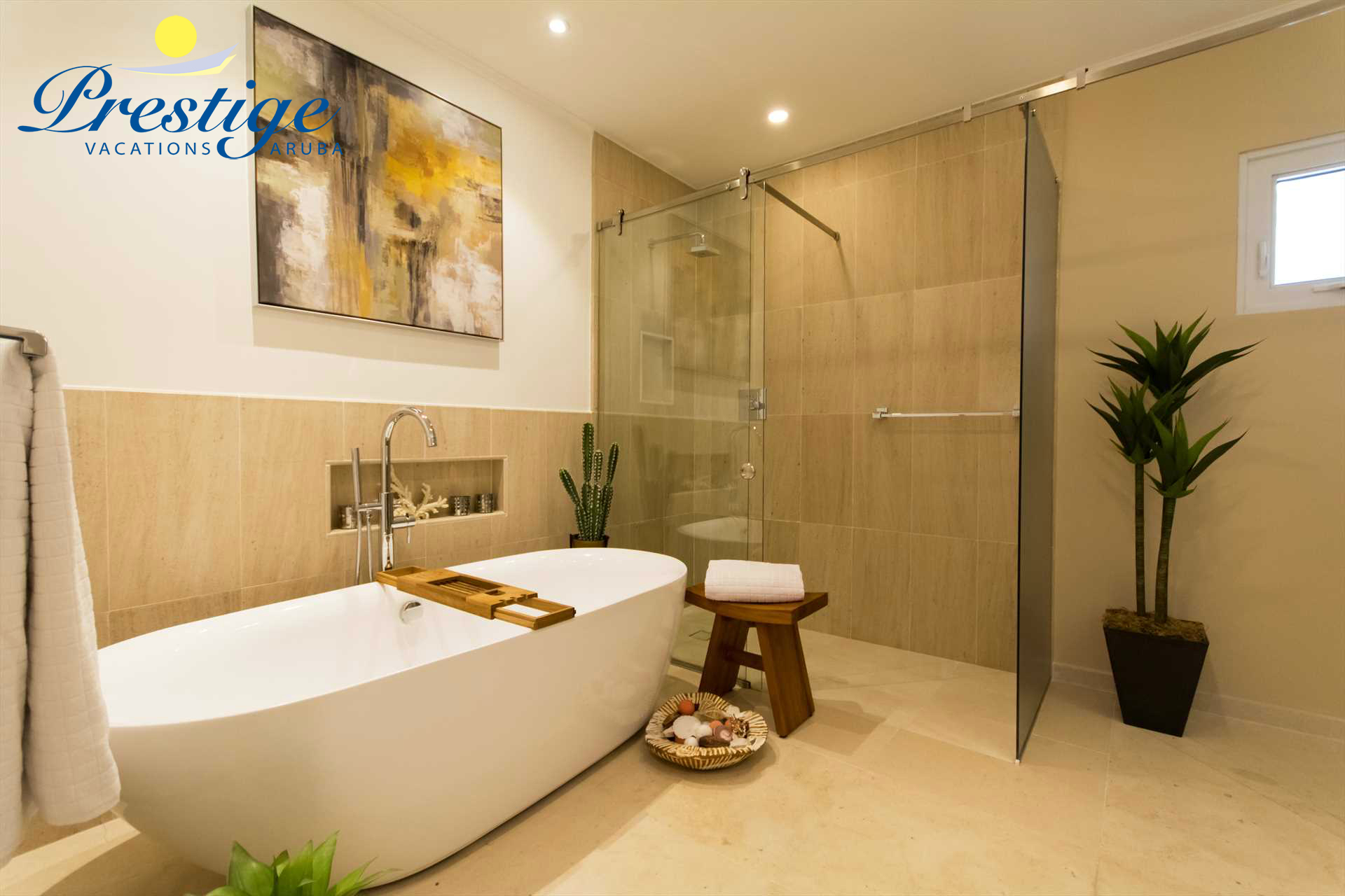 A glass-enclosed shower area plus a free-standing bathtub to soak and calm down during your stay