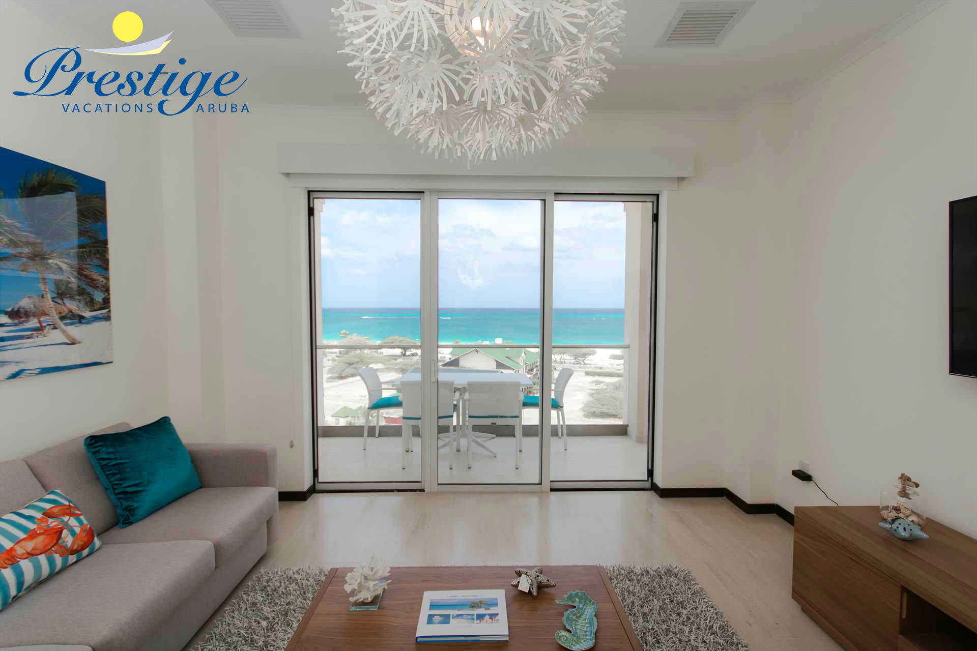 Living area with access to balcony with amazing ocean views!