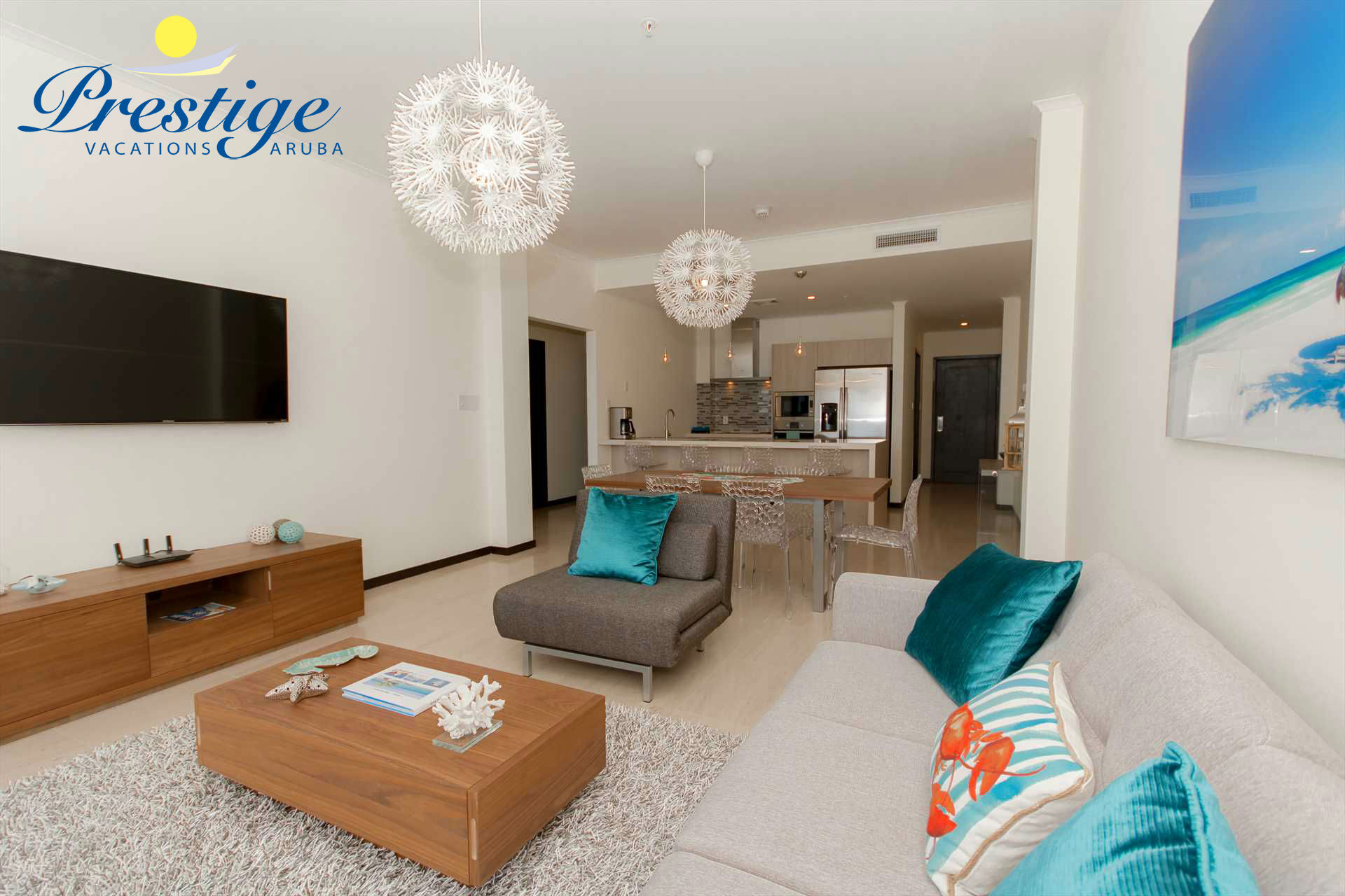 The open plan living area is provided with a sofa-bed (with a double-size mattress), a chair and TV