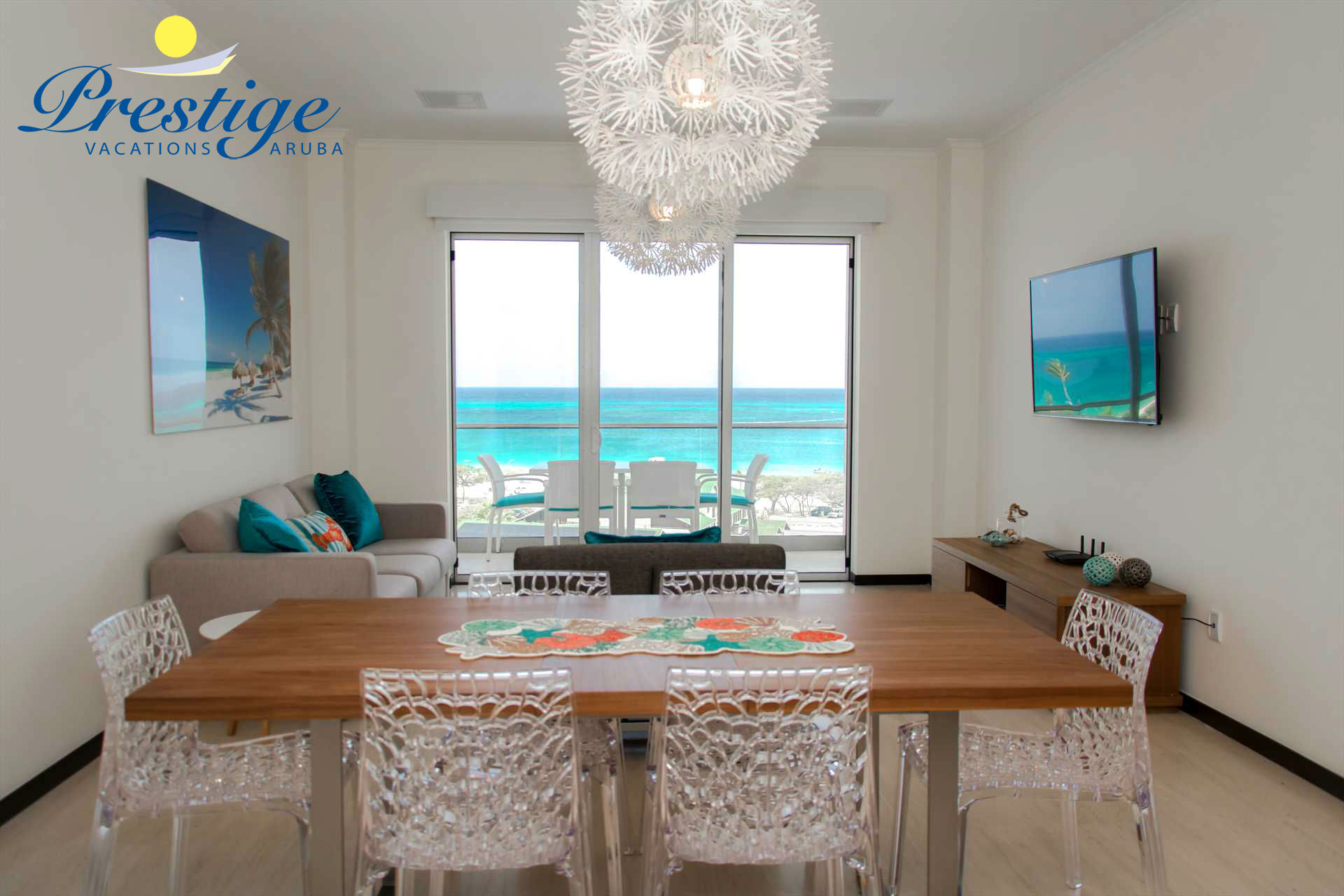 Welcome to your Teal View Two-bedroom condo, living room with ocean views!