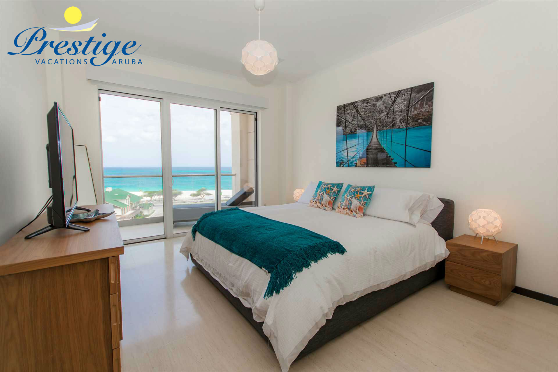 Master bedroom with king-size bed and access to the balcony