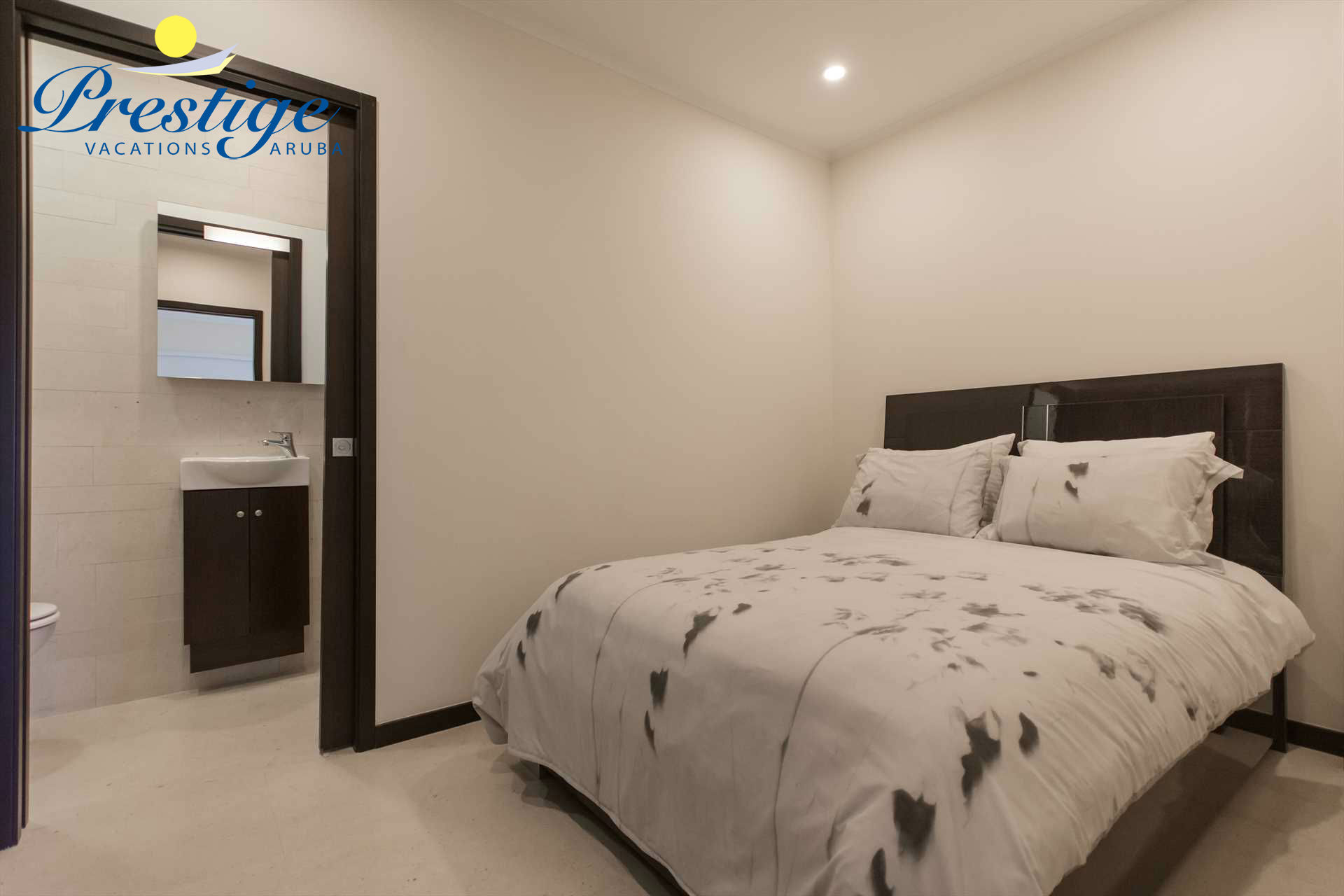 An additional separate room which has a double-size bed and an en-suite bathroom