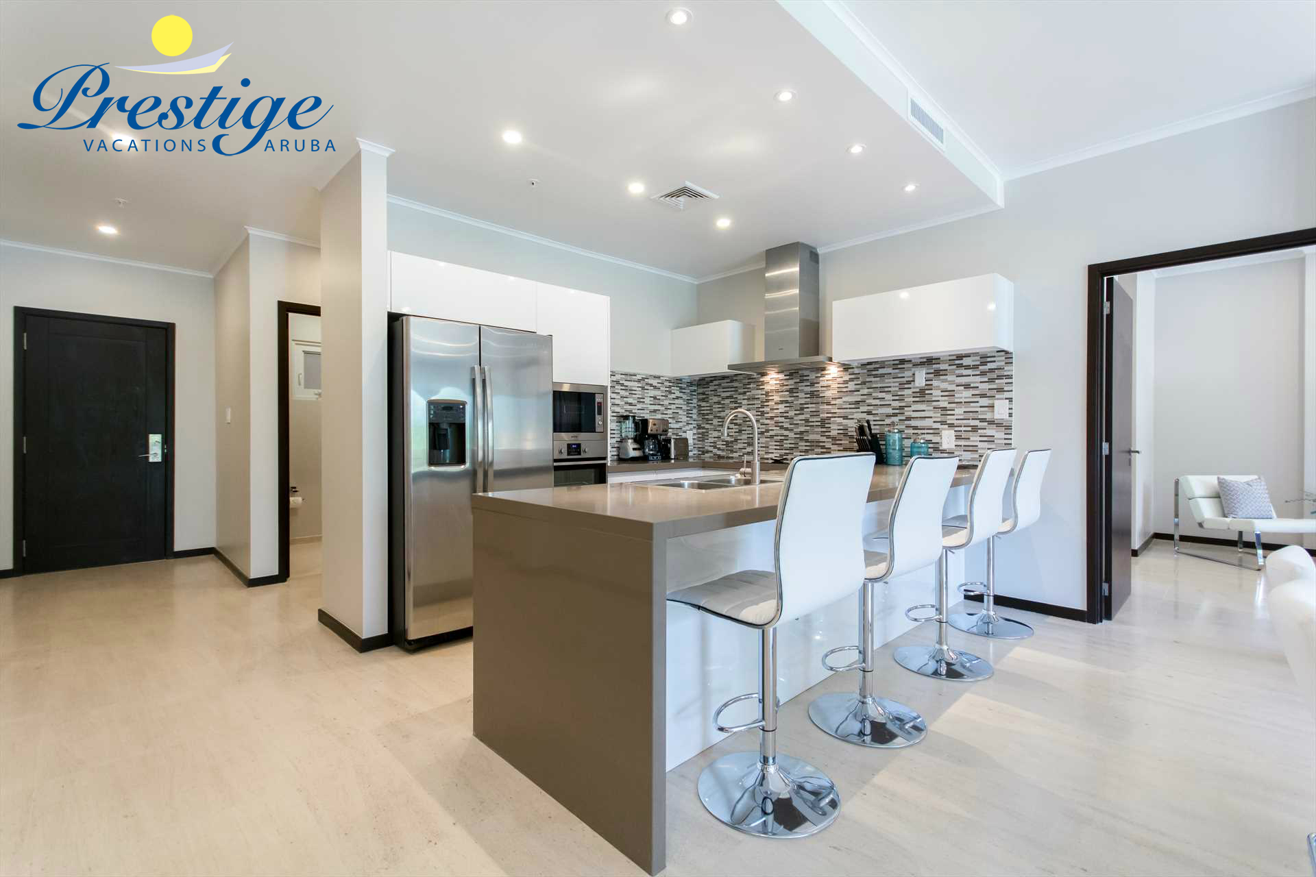 Full-sized fully equipped modern kitchen with 4-barstools