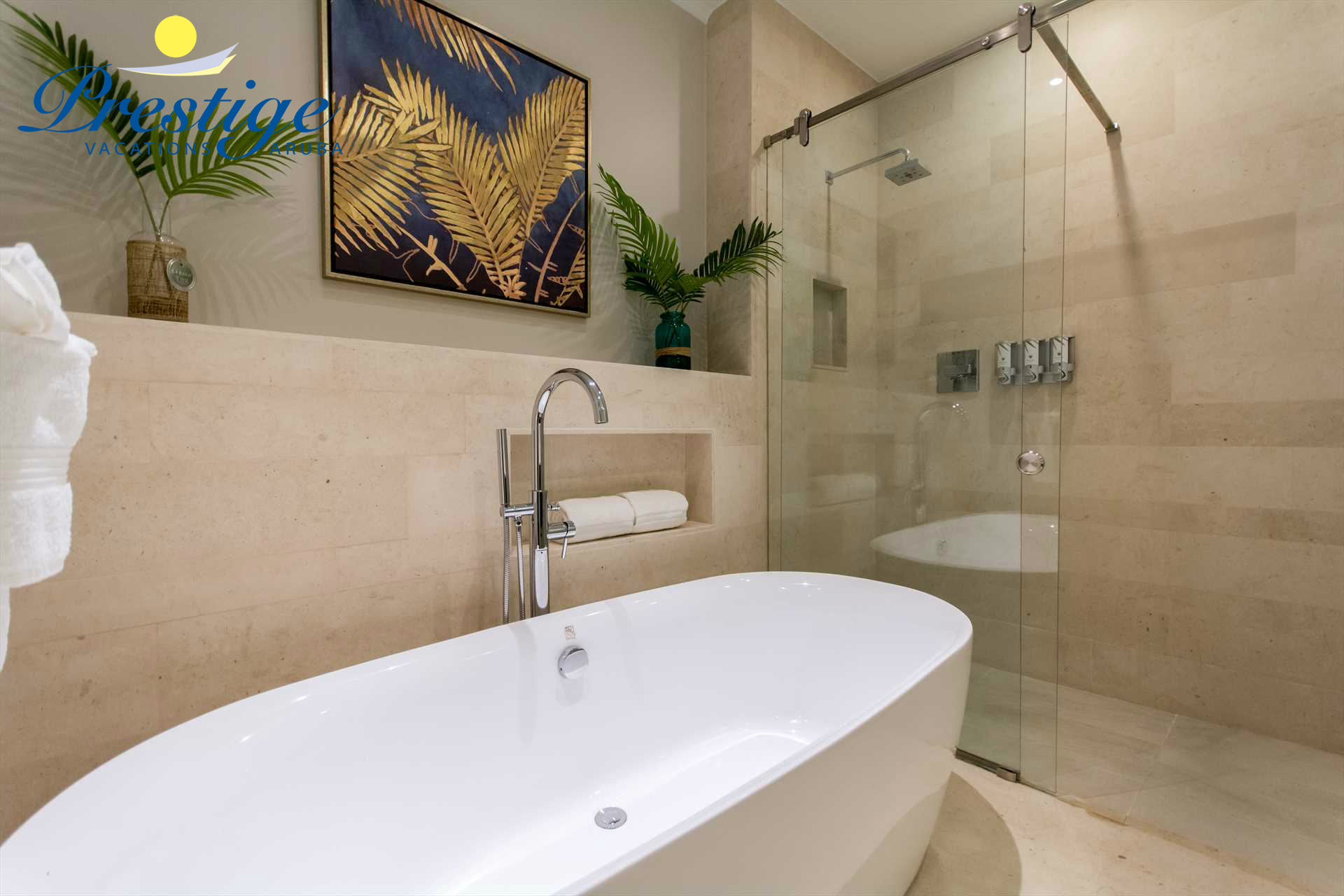 A glass-enclosed shower area plus a free-standing bathtub to soak and relax during your stay