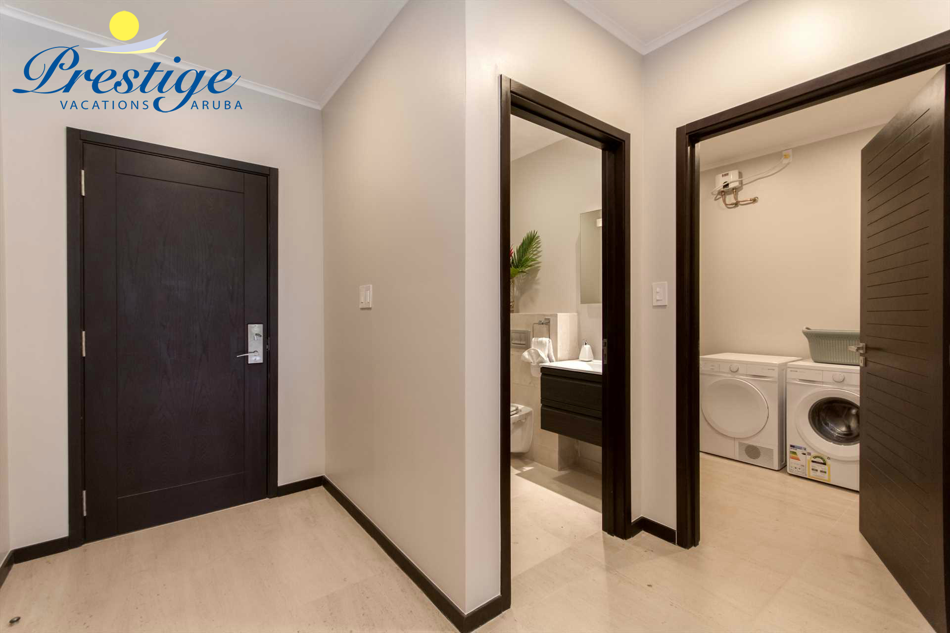 The entrance corridor lends access to a half bathroom and laundry room