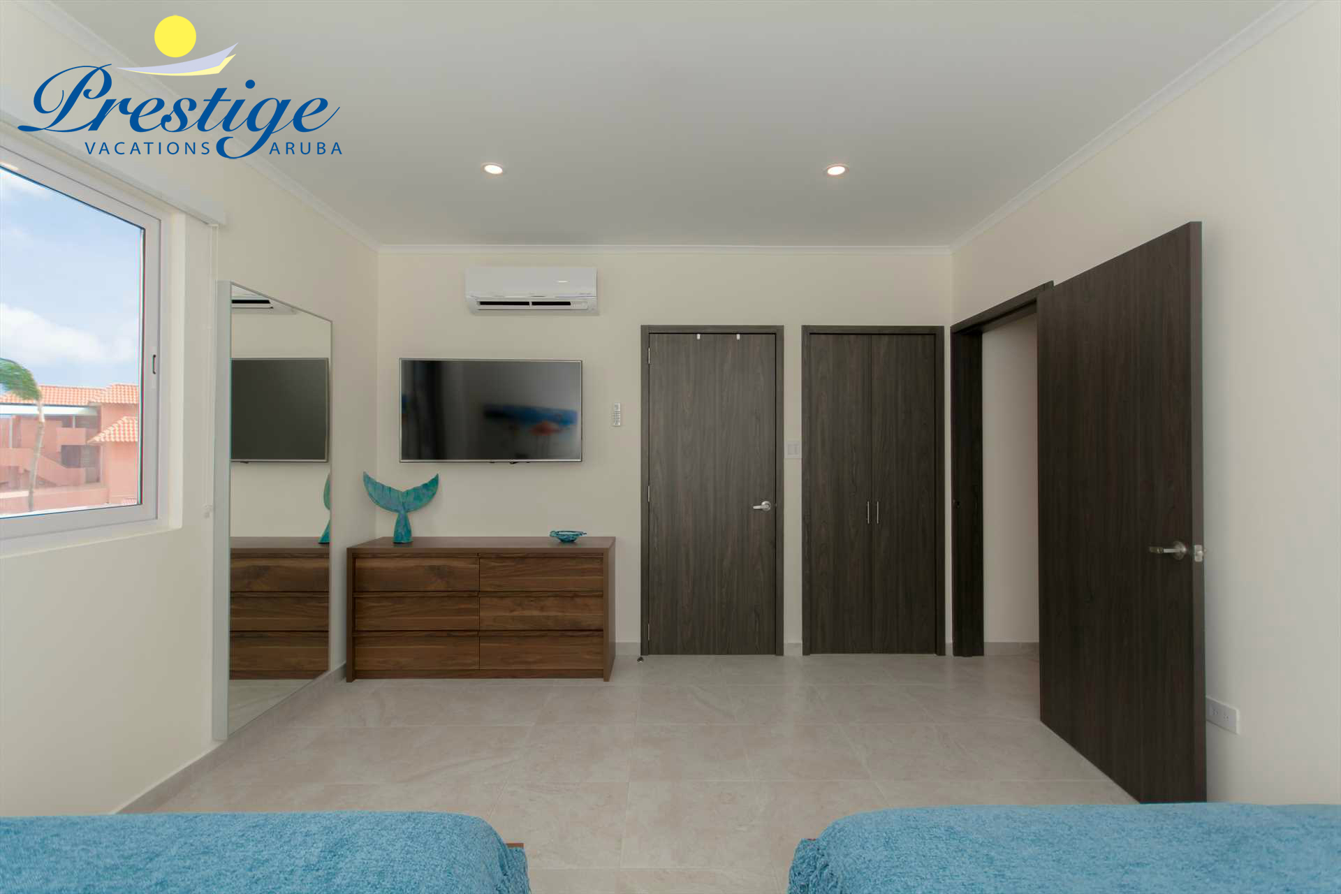 The second bedroom with TV, walk-in closet and en-suite bathroom