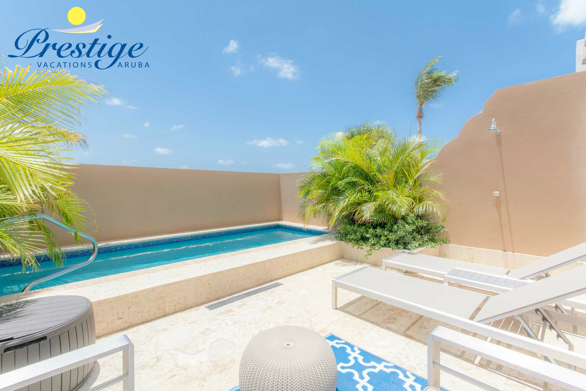 Back patio with outdoor seating area and 2-chaise lounges to relax by the pool