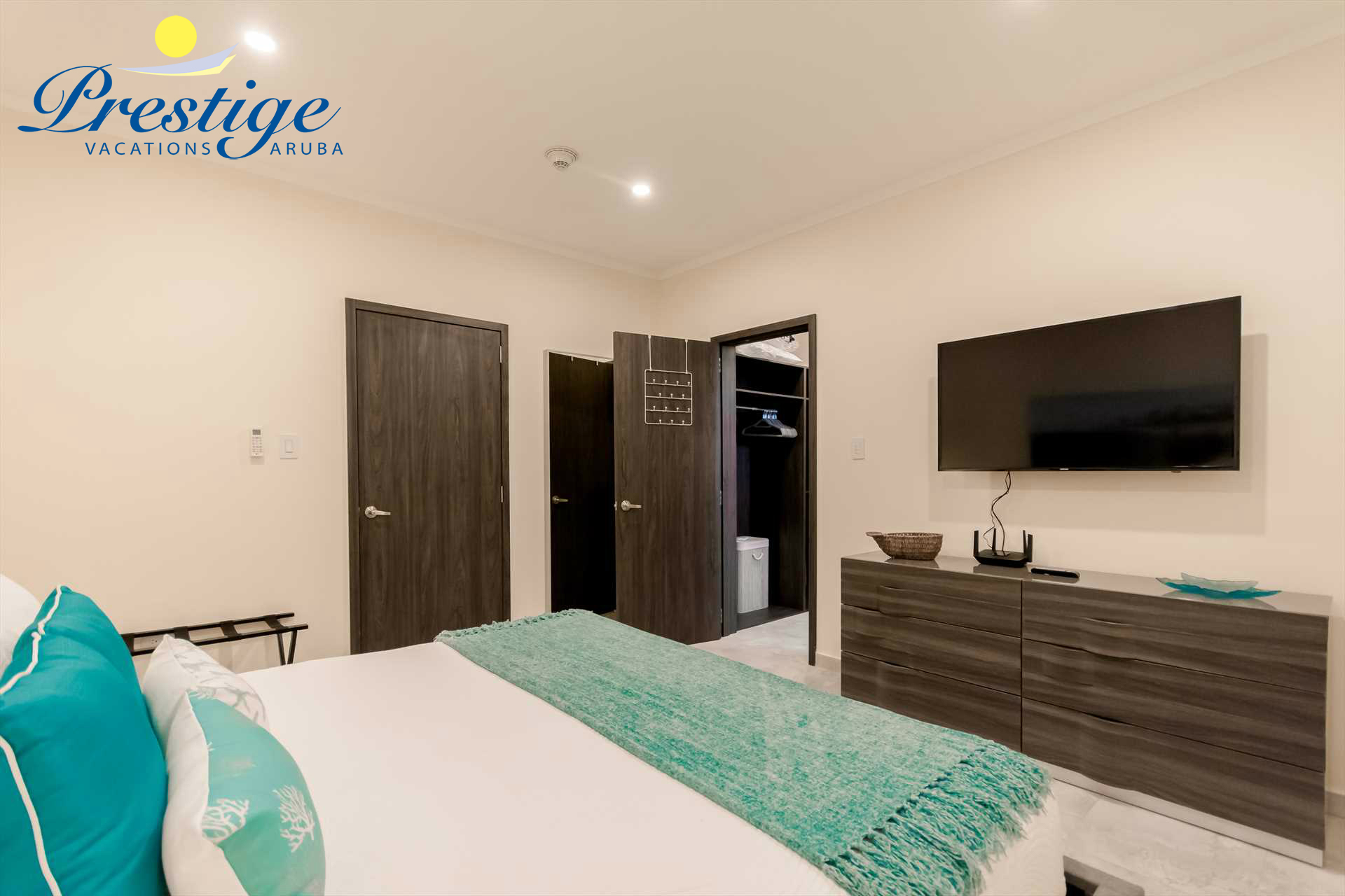 Master bedroom with a TV and a walk-in closet that connects you to the en-suite bathroom