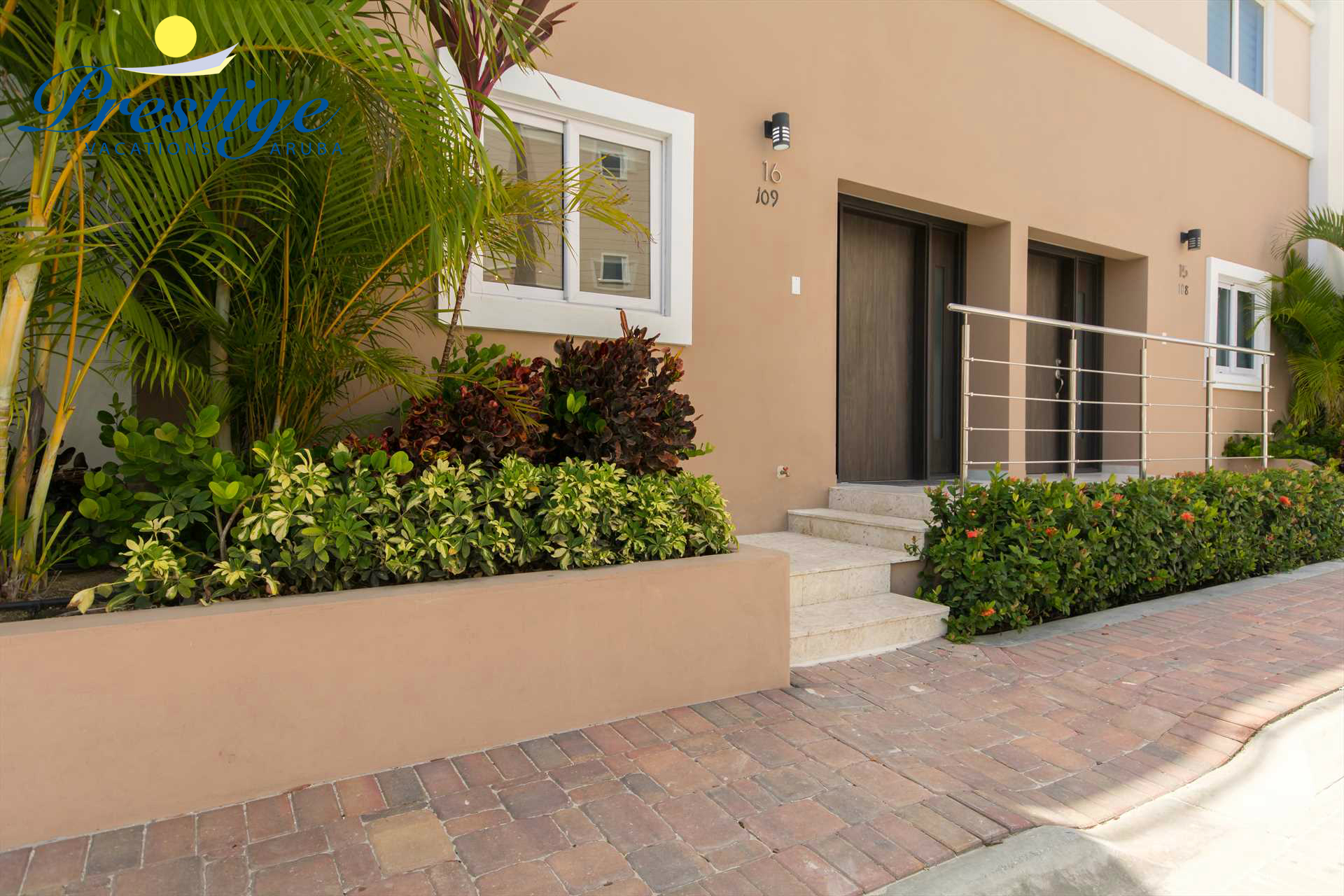 The entrance of your luxury vacation rental beach home just steps from Eagle Beach