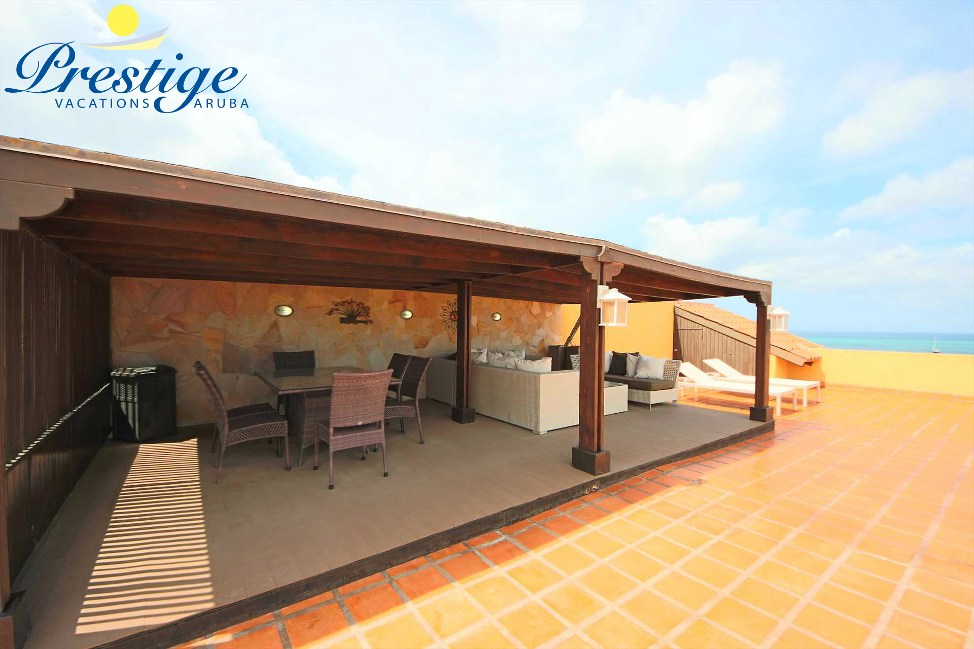 Large gazebo on the rooftop with dining and seating area
