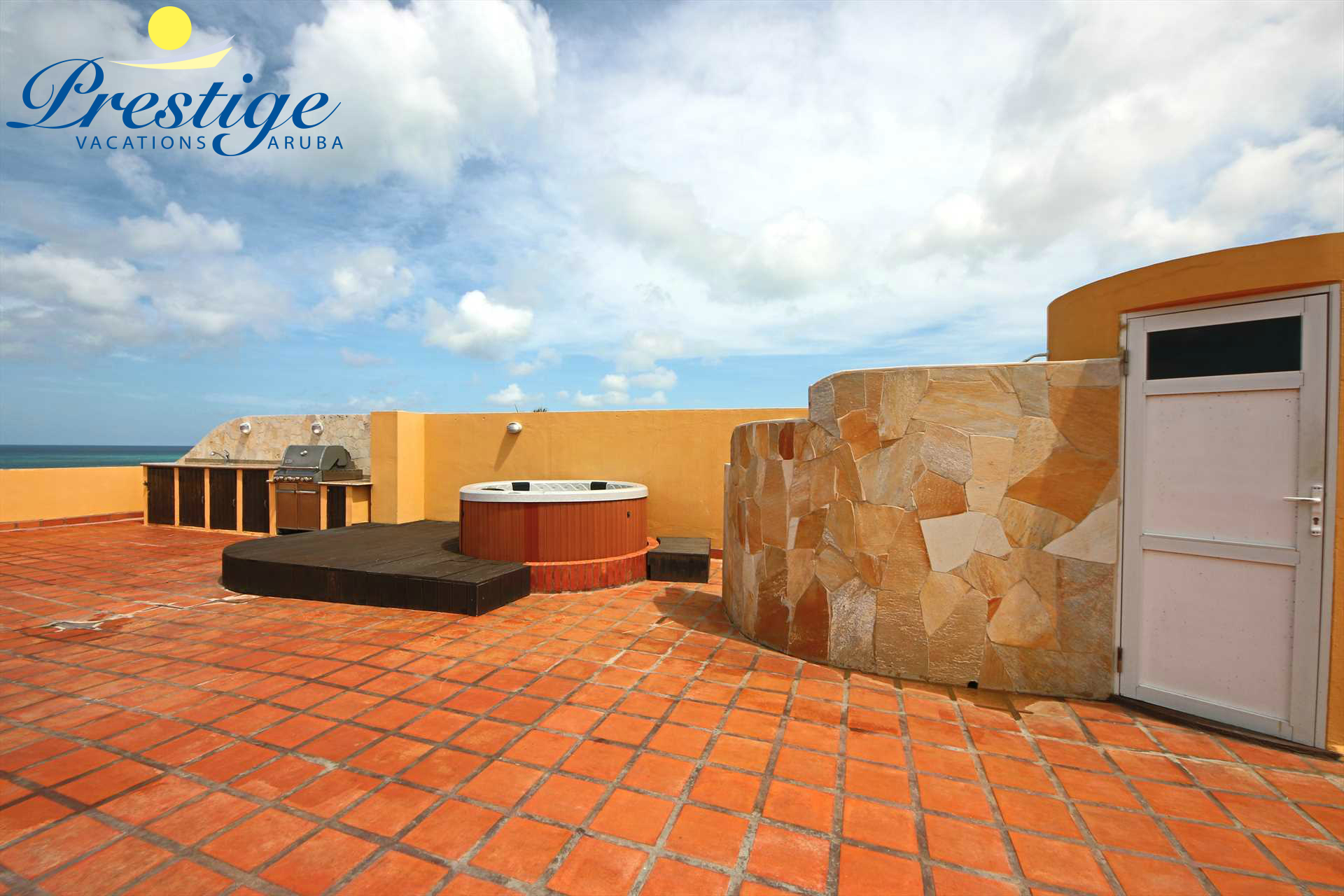 Your private rooftop terrace with hot tub, outdoor kitchen with BBQ-grill, and outdoor shower