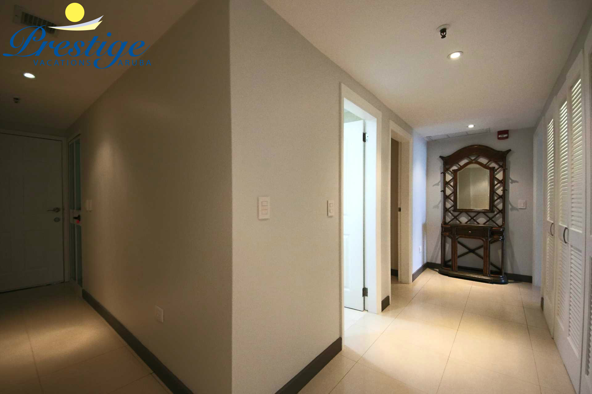 The hallway that lens access to the bedrooms and laundry facilities