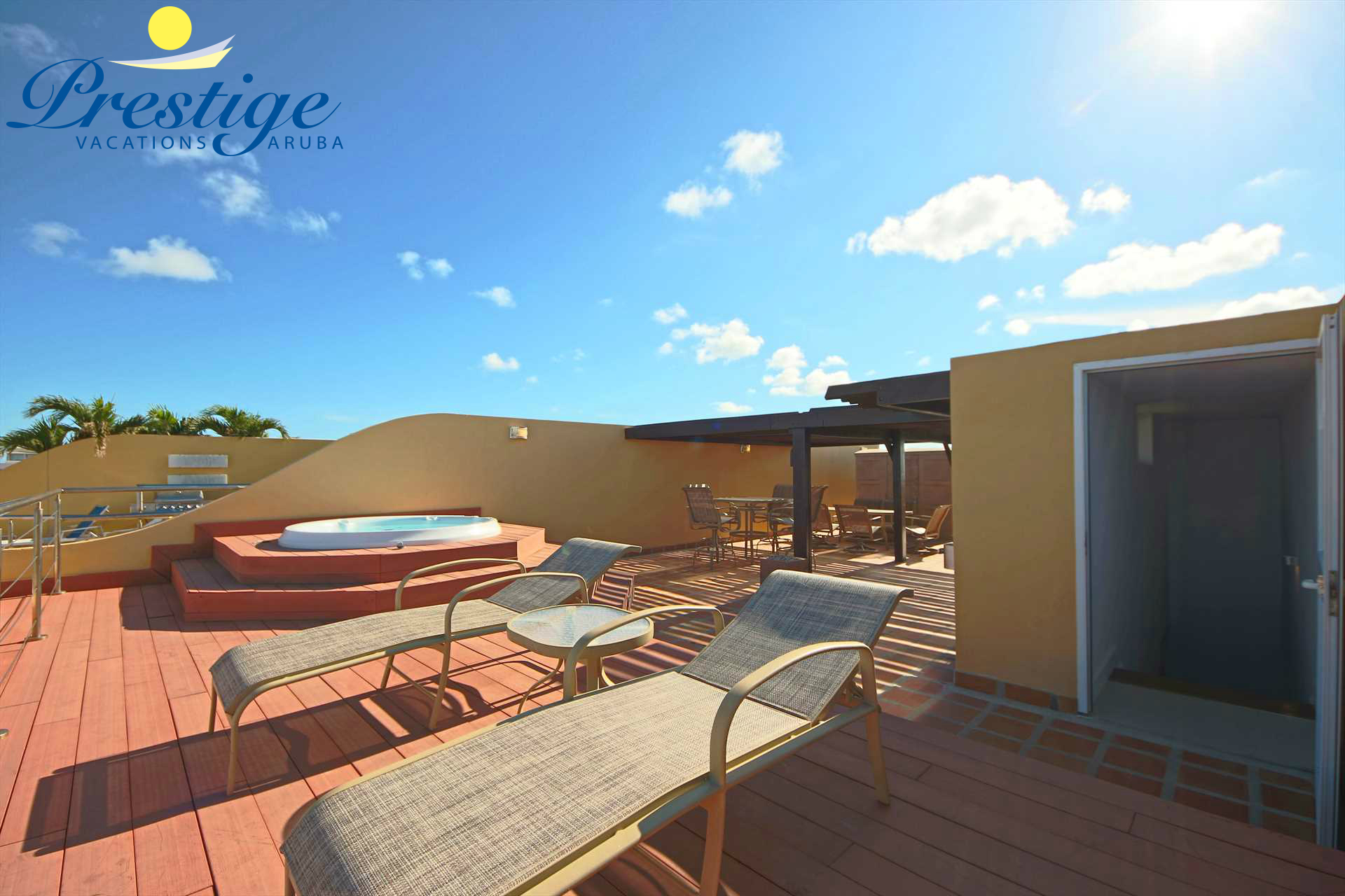 The deck with your Hot Tub plus 2 lounge chairs and the access to your private rooftop