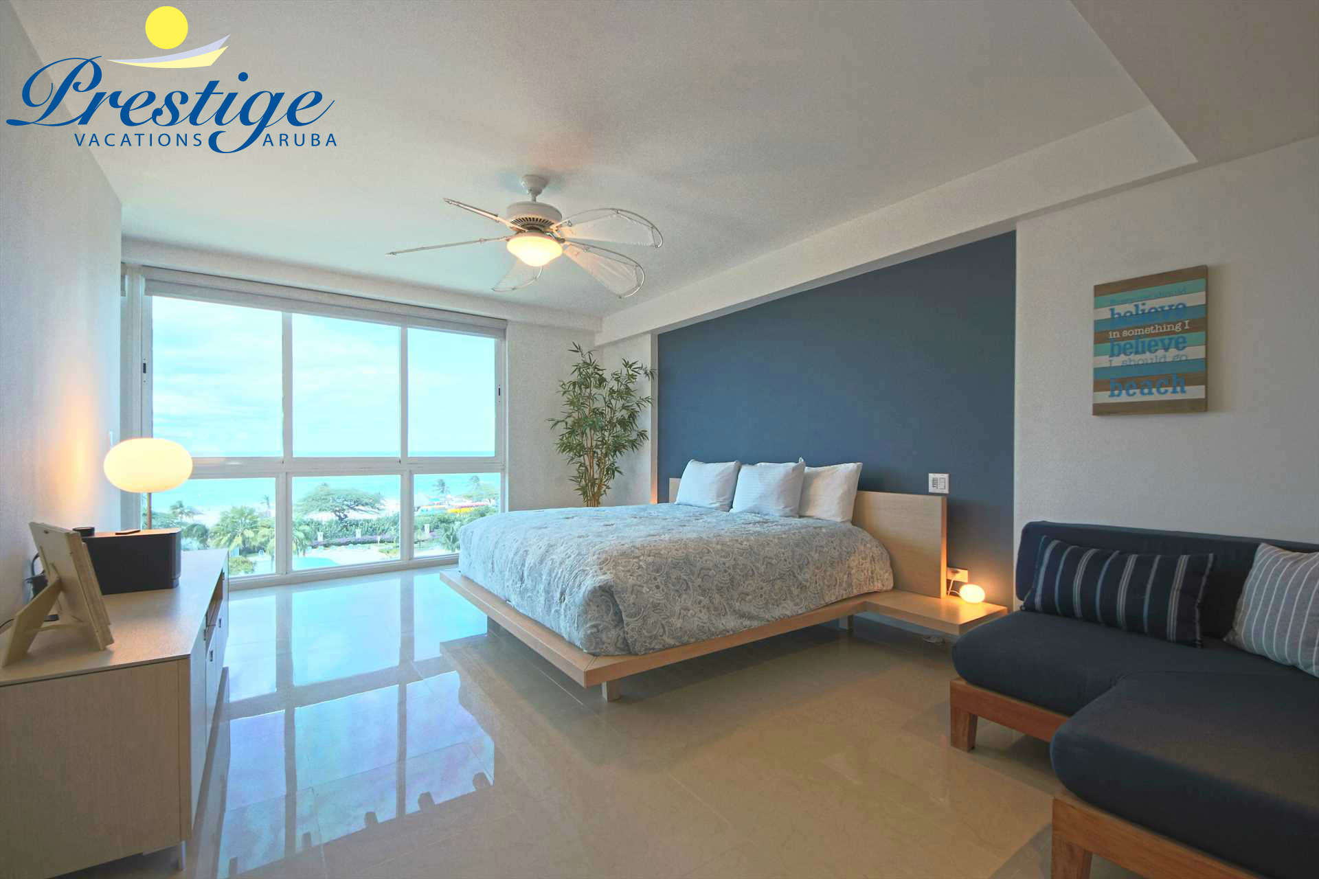 The master bedroom with a large glass window to indulge the ocean views from every corner