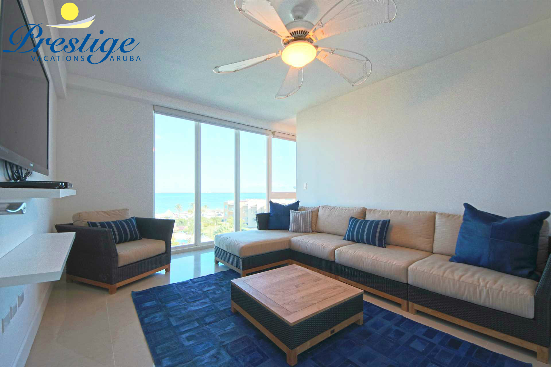 Separate seating area with a large TV in the master bedroom with stunning views too