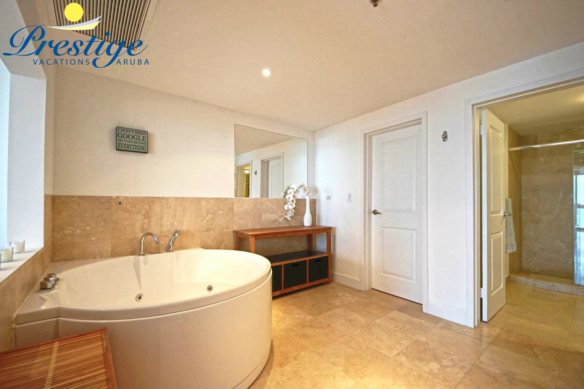 The master en-suite bathroom with a round jetted bathtub