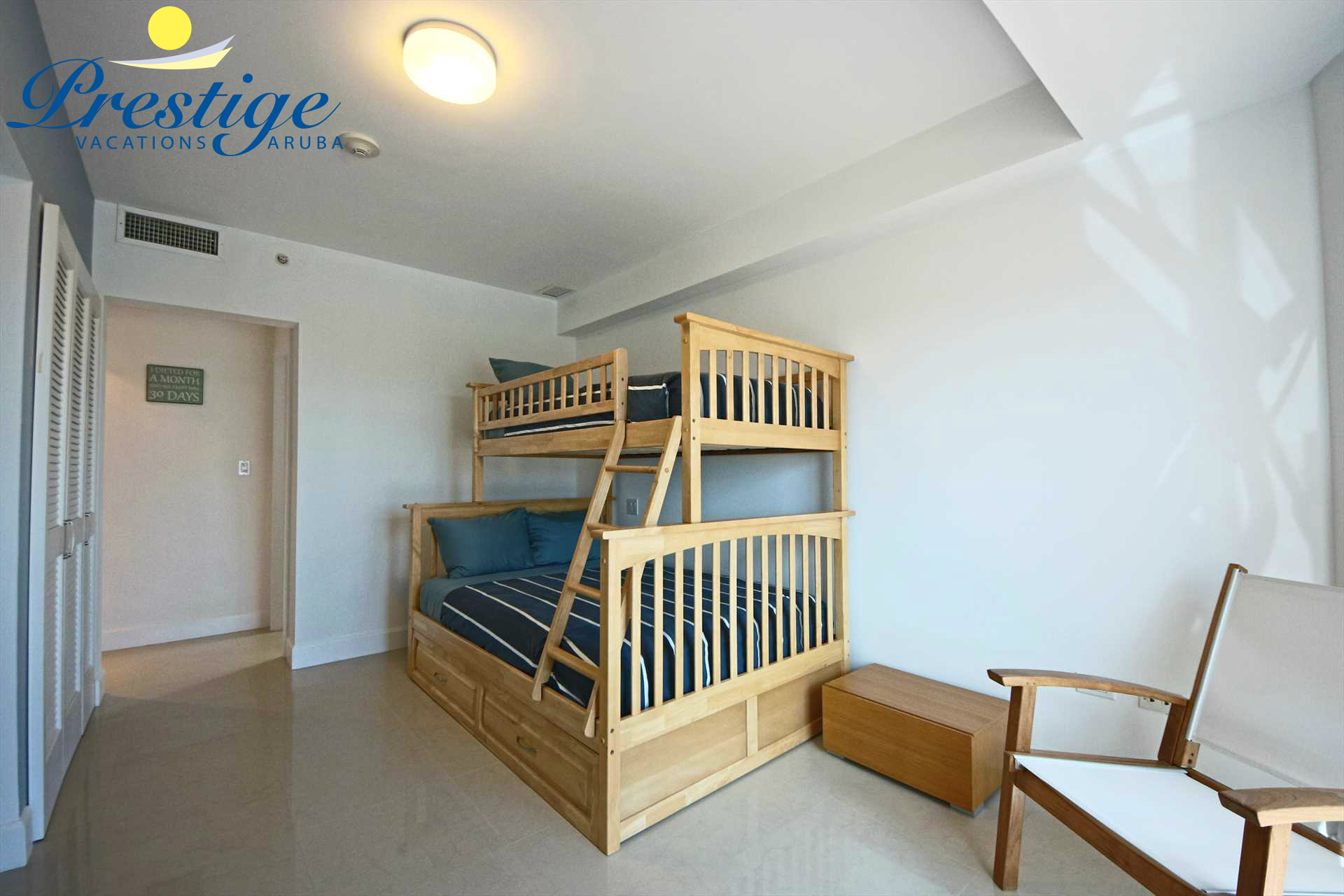 Third bedroom with a full-size bunk bed and twin-size bed on top plus a trundle bed (twin-size)