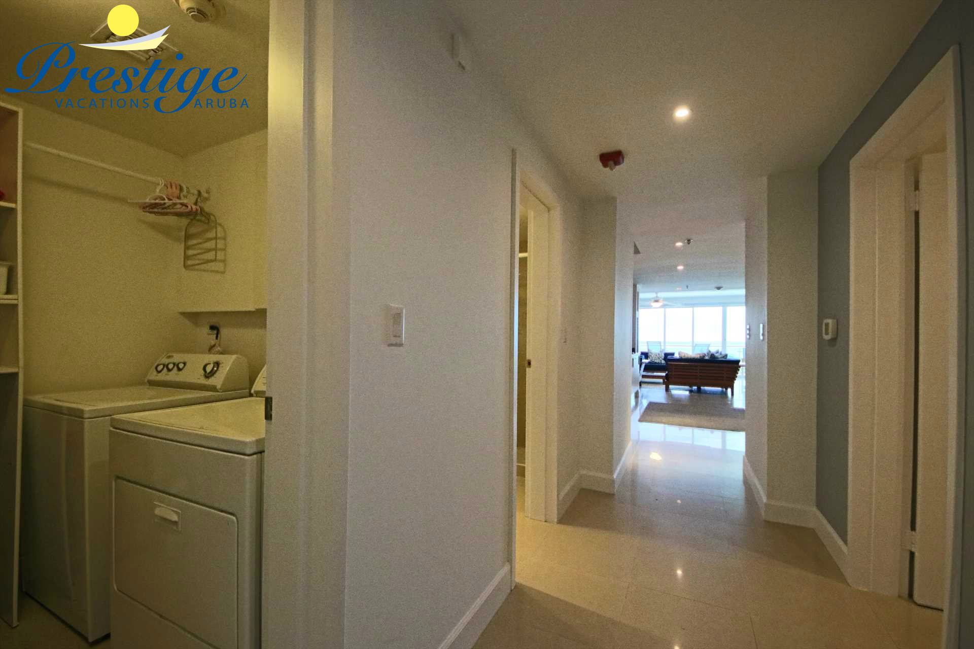 The entrance corridor with laundry room with washer/dryer plus access to the fourth bedroom and bathroom