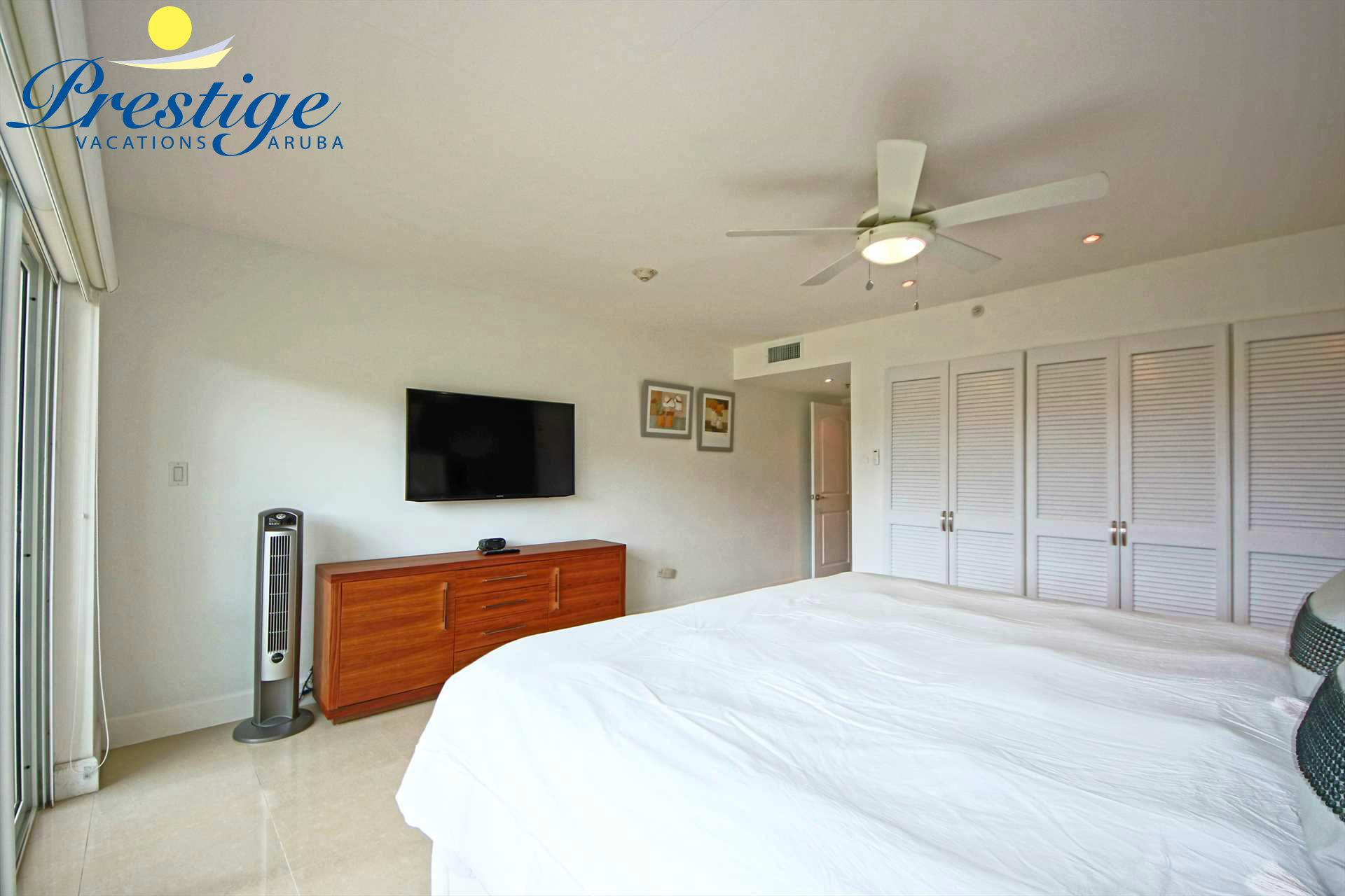 The master bedroom with a TV and built-in closets
