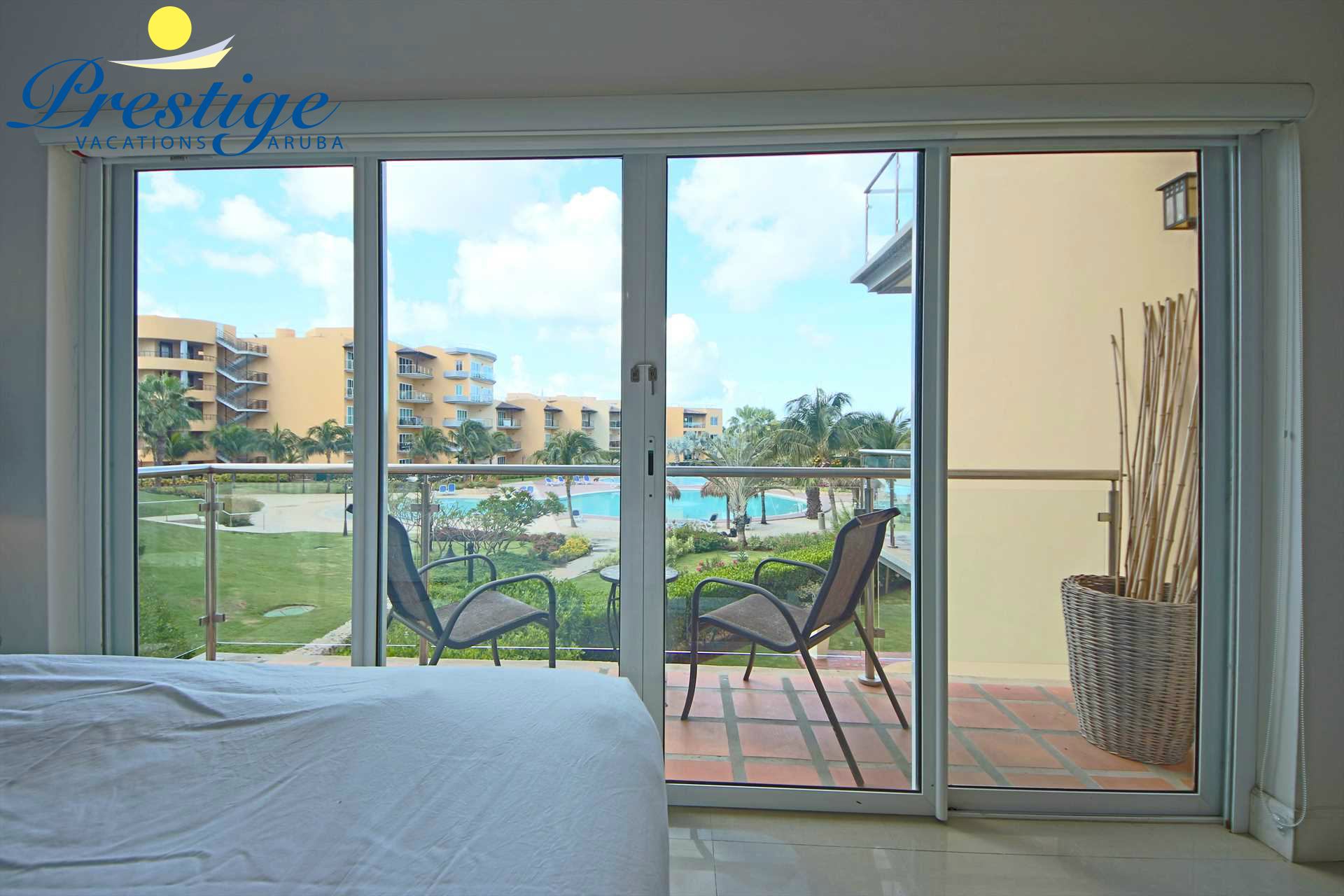 The master bedroom balcony with amazing resort pool and ocean views