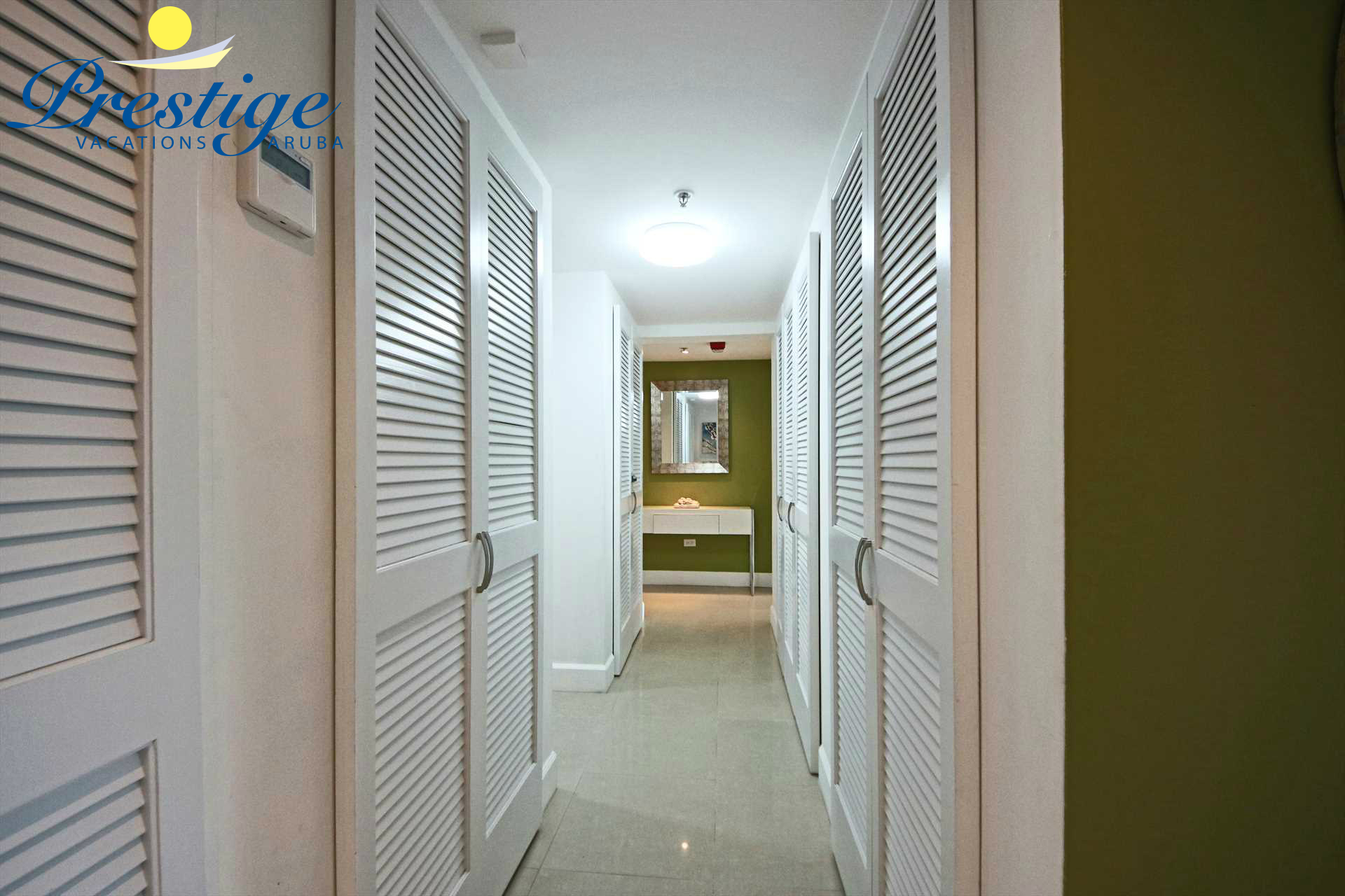 The corridor that lends access to the bedrooms, third bathroom plus the laundry facilities