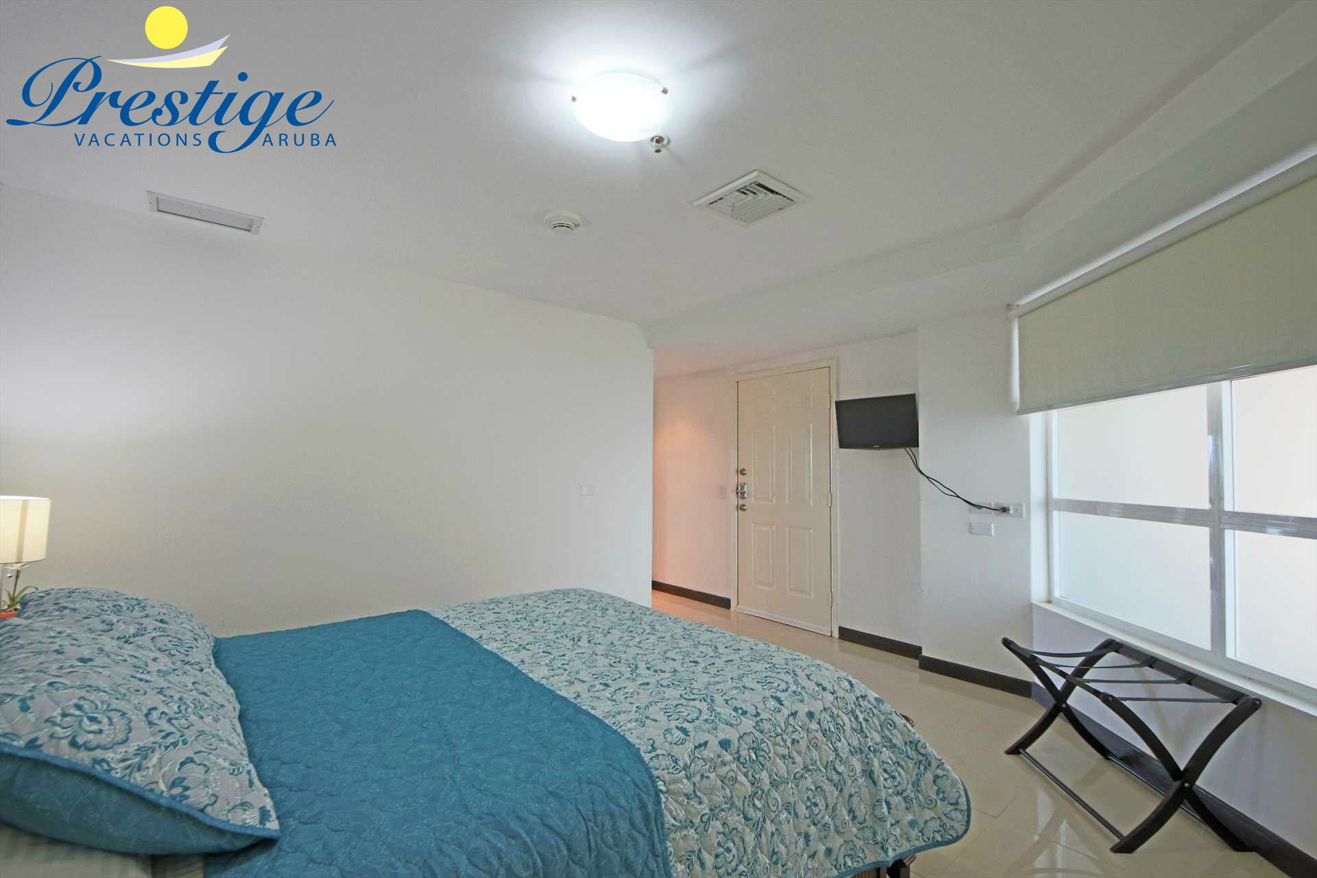 The second bedroom has a TV and an en-suite bathroom with a shower.