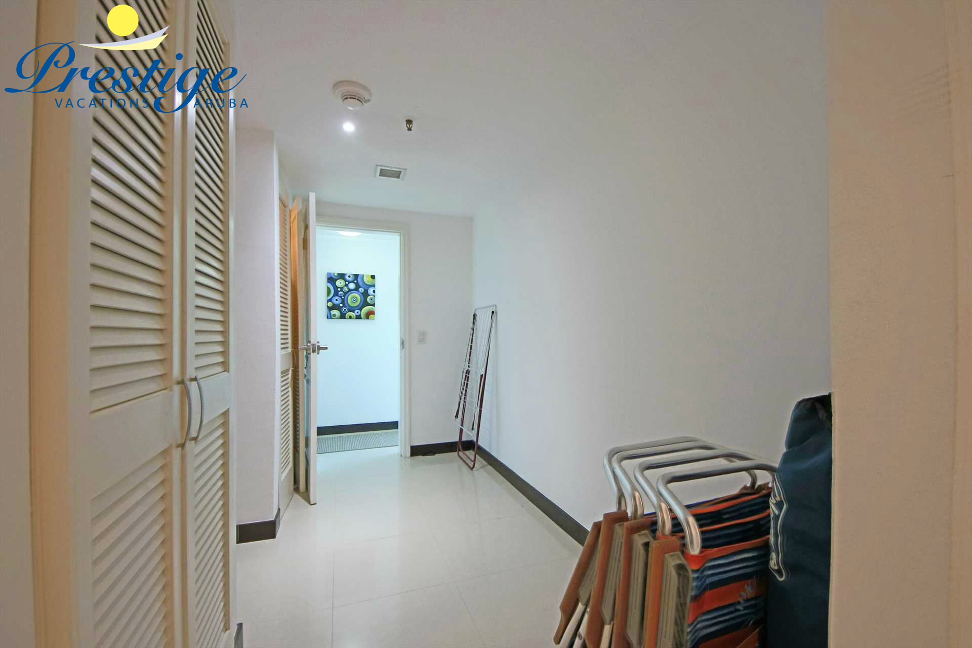 The corridor that lends access to the beach chairs, bedrooms, third bathroom plus the laundry facilities