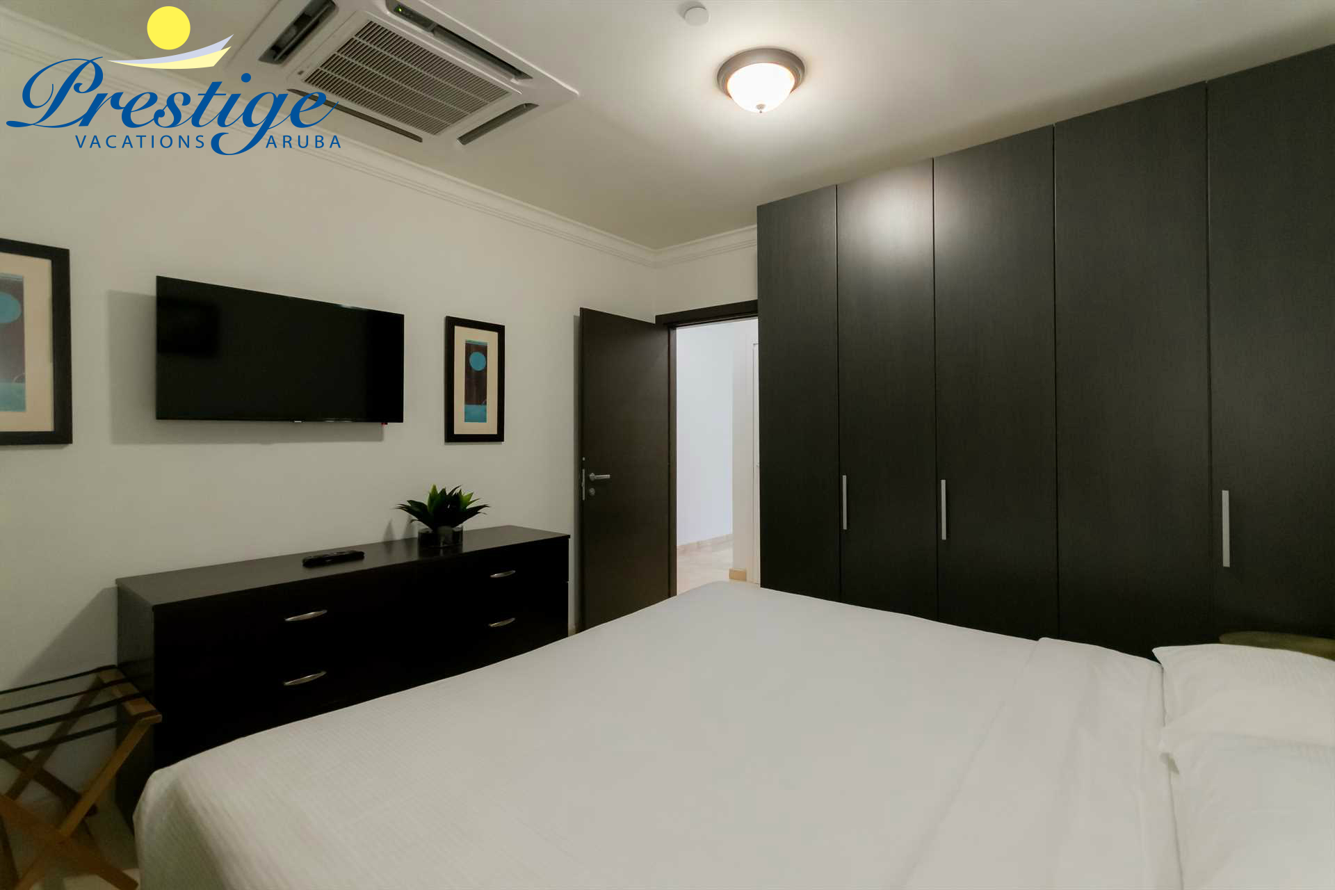 The master bedroom features a built-in closet and a TV