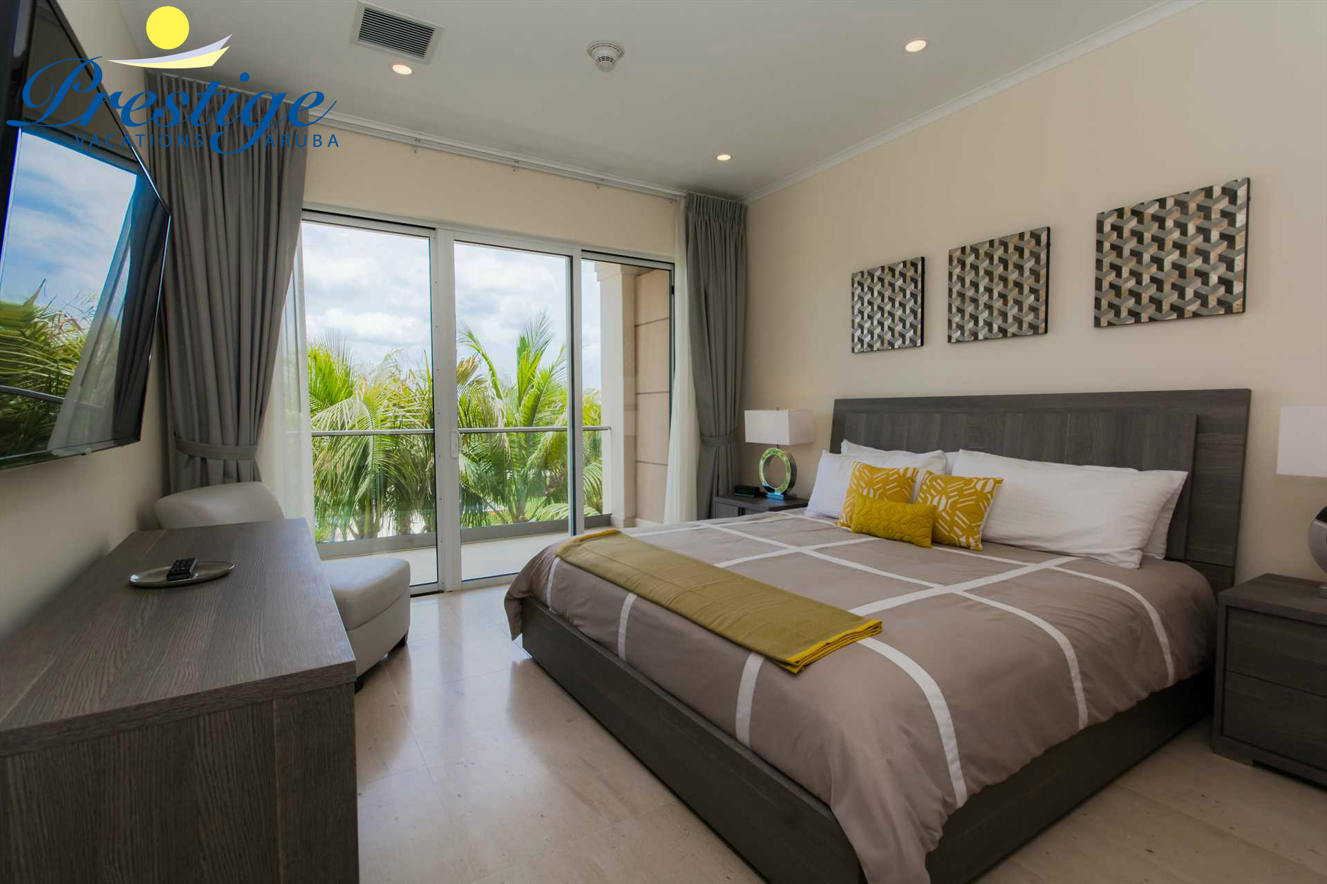 Master bedroom with king-size bed and access to balcony