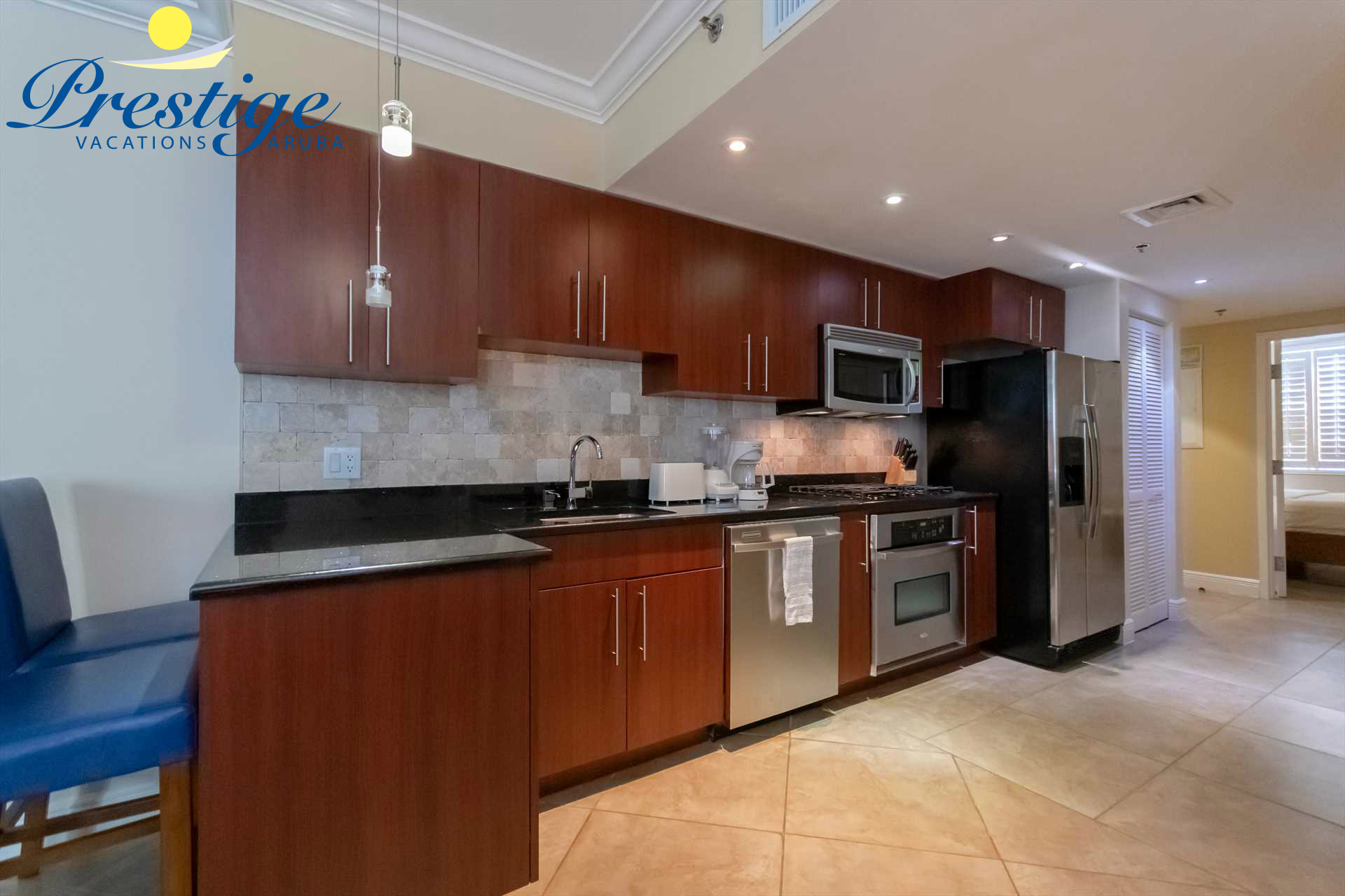 Your full-sized fully equipped kitchen with 2-bar stools