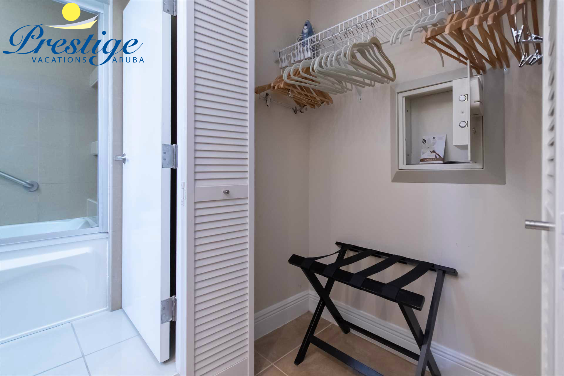Master bathroom with a built-in closet and an in-room code-lock safe