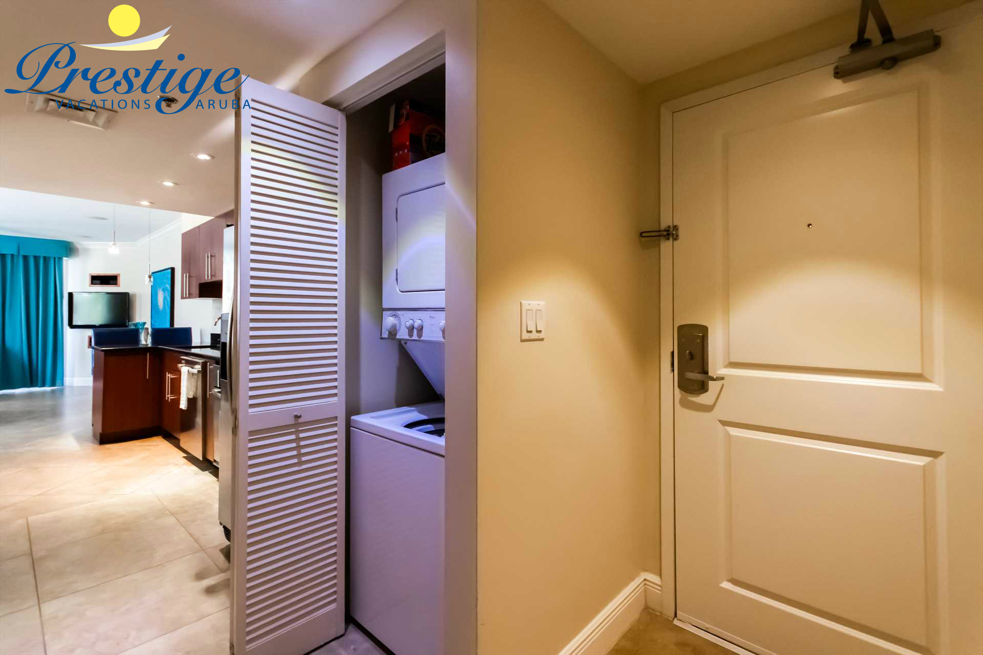 Condo entrance and the in-room washer/dryer closet