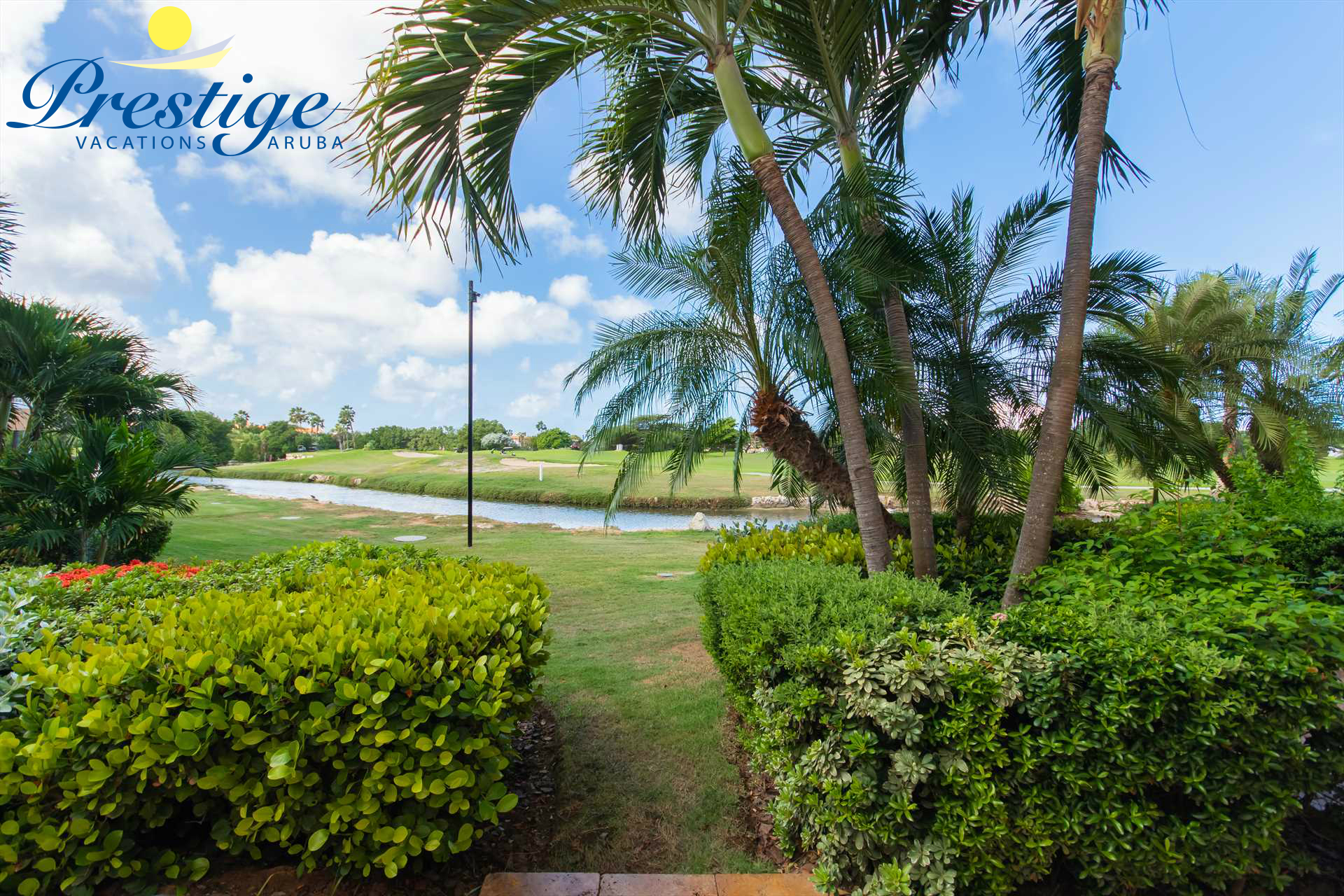 Your serene views of the golf course, resort garden, and Aruba's year-round summer weather