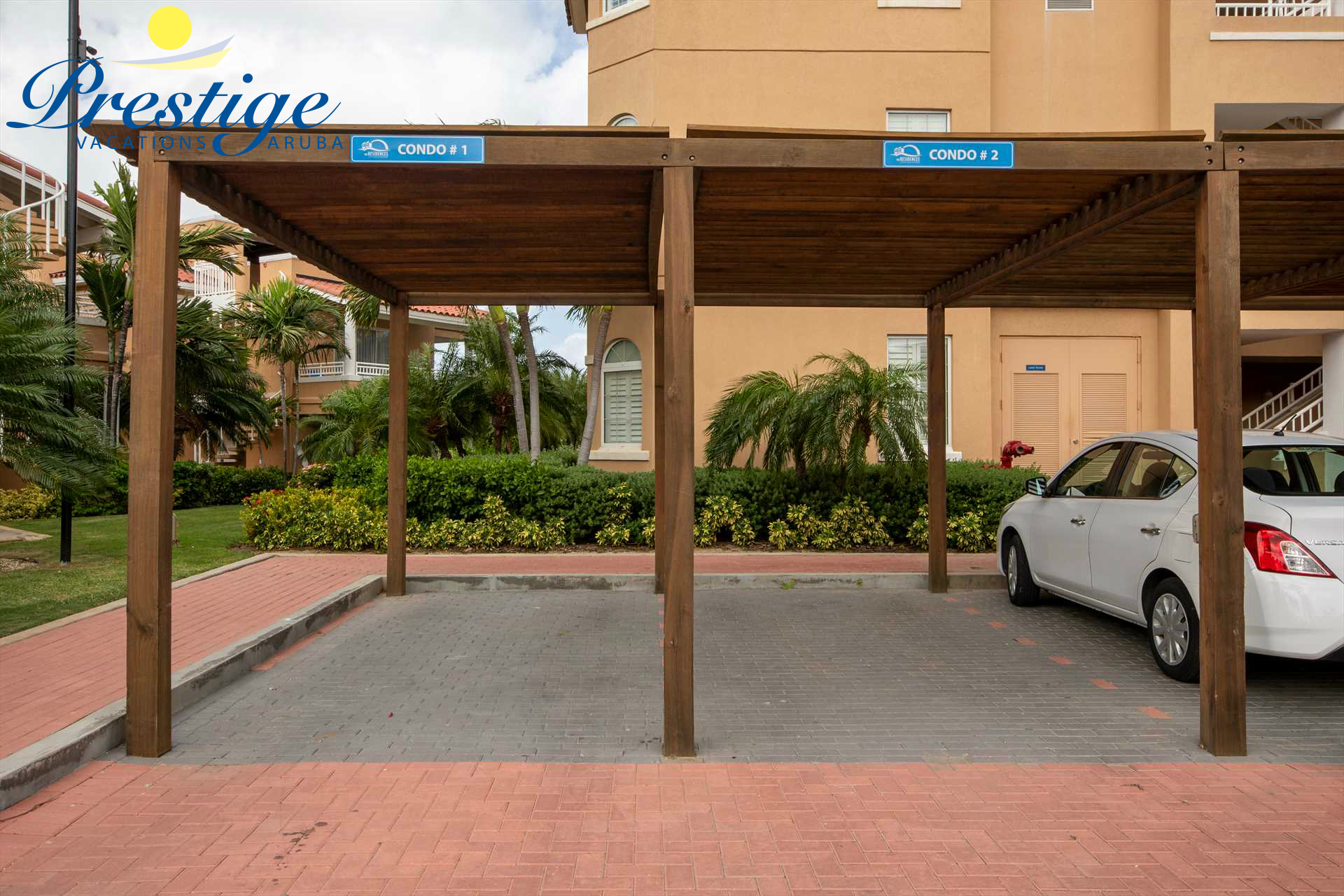 Your designated parking space in front of the building, numbered: Condo 2