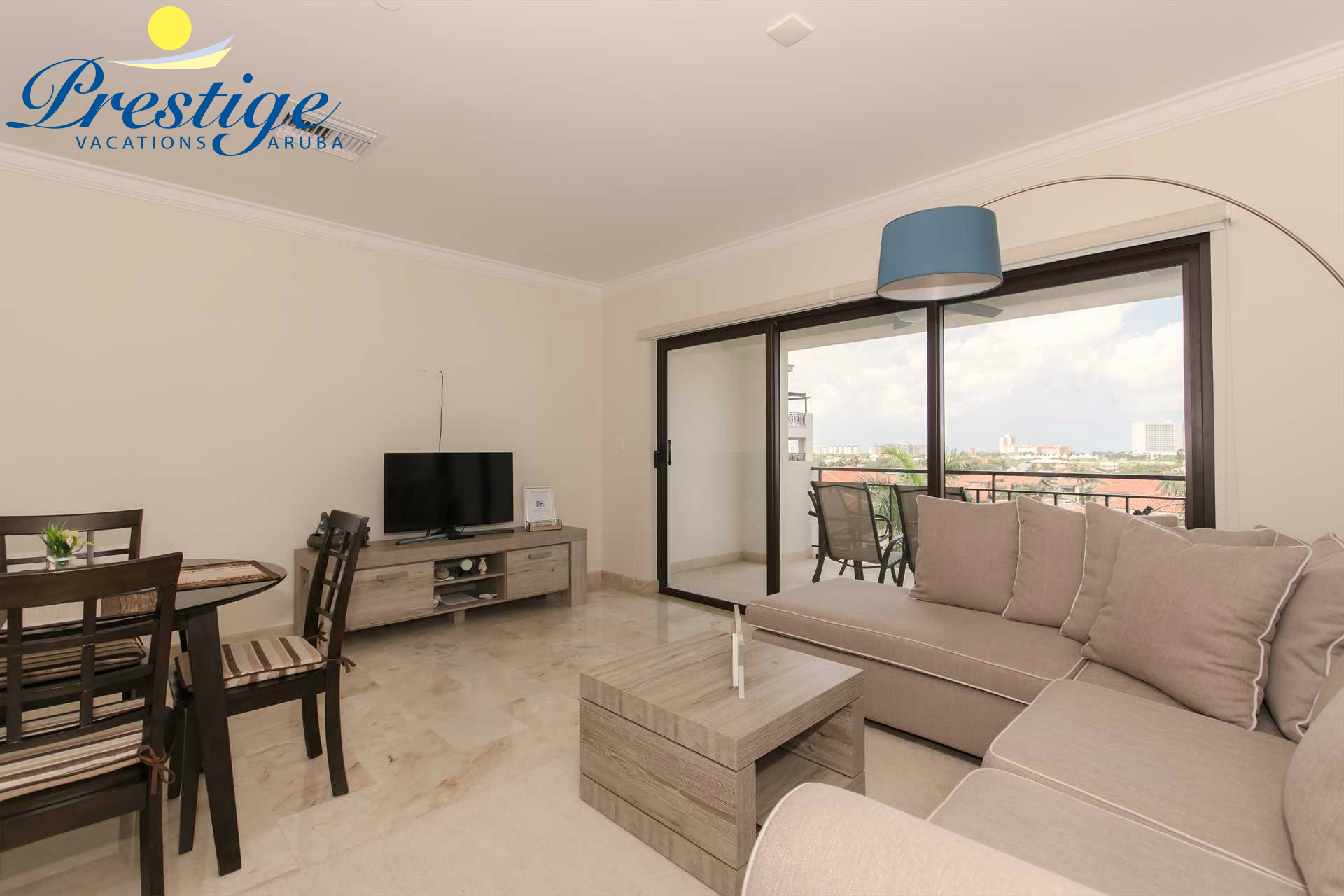 Living room with a TV and access to balcony