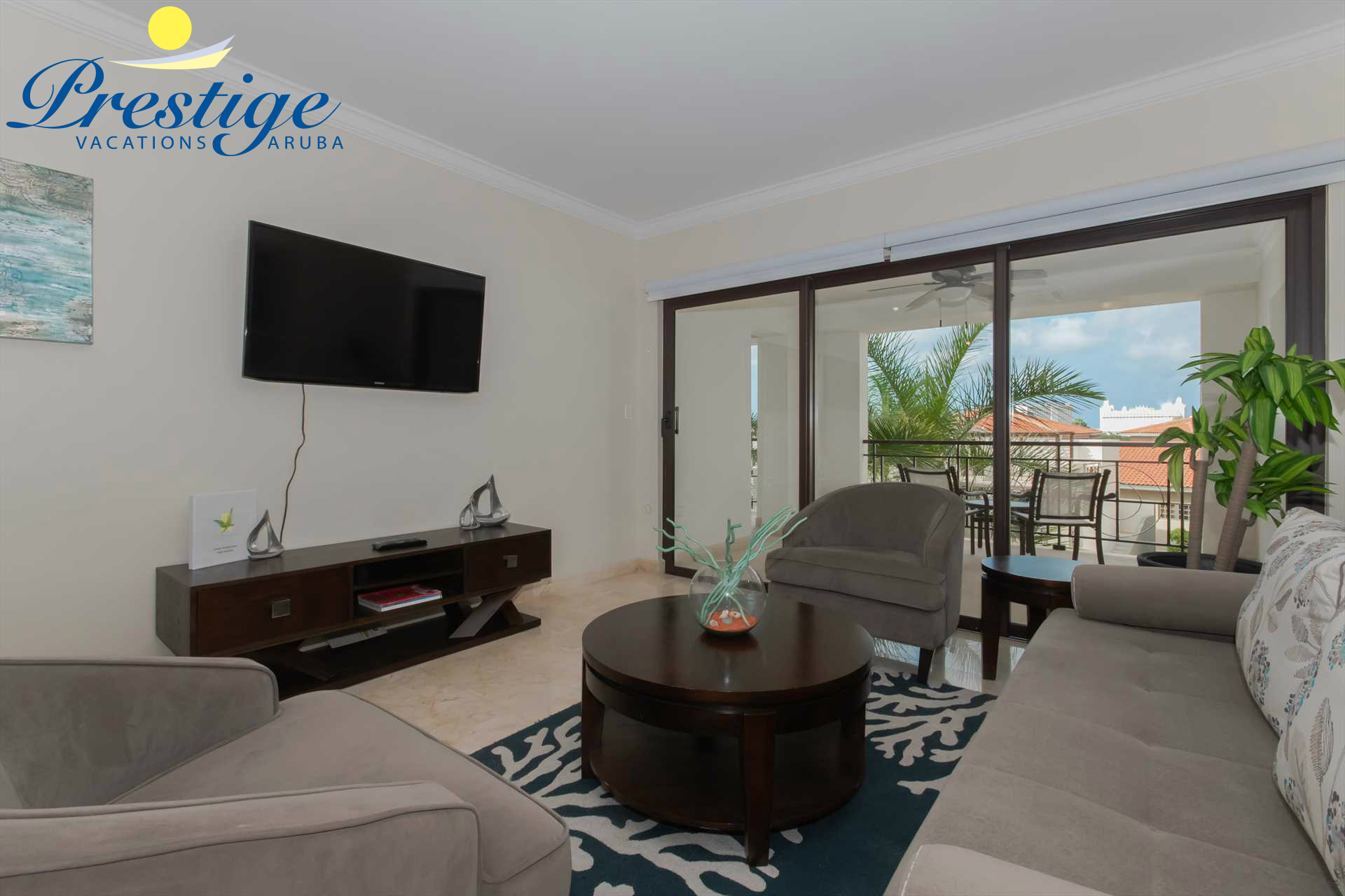 Living room with a TV and access to the balcony