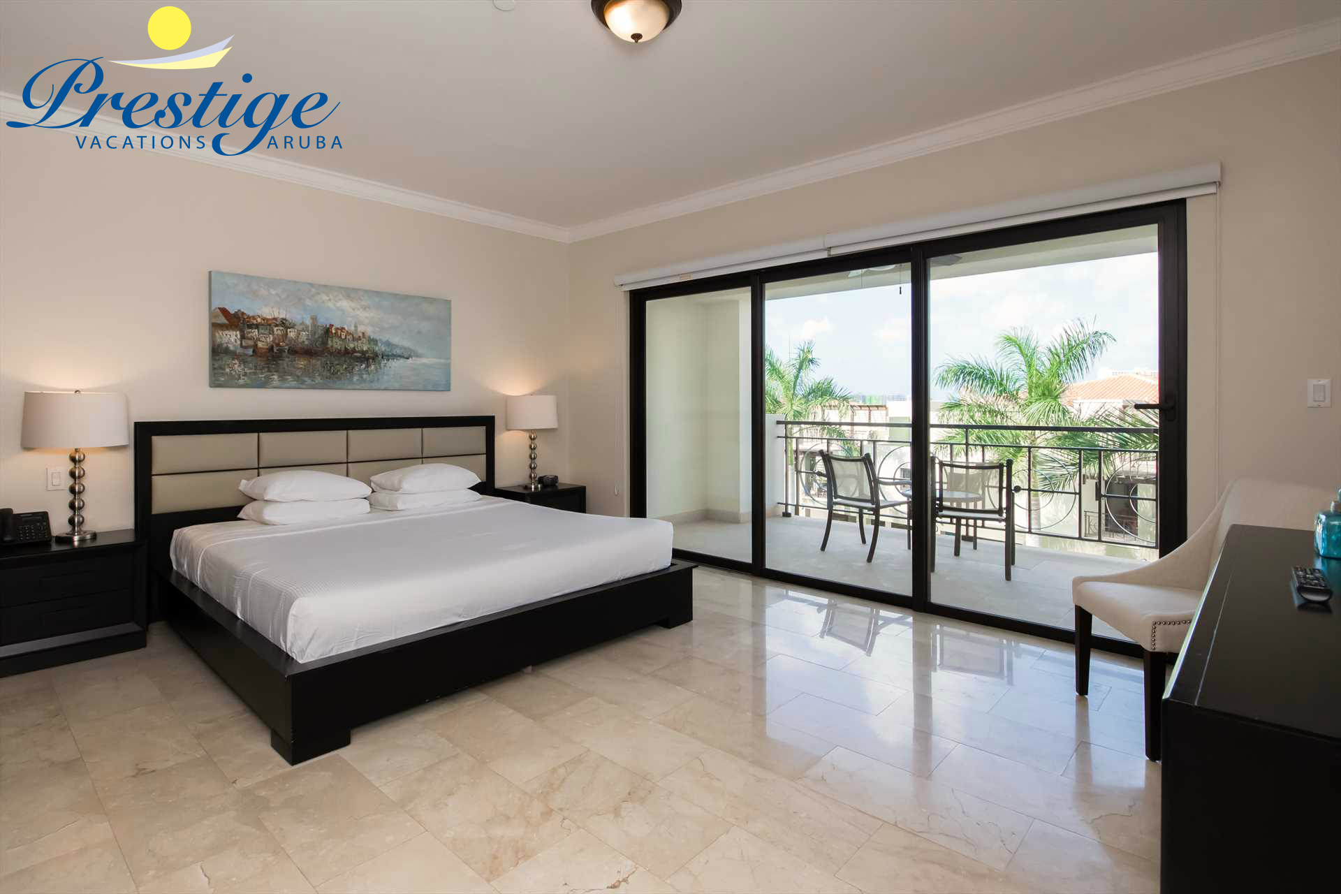 Master bedroom with a king-size bed and access to the balcony