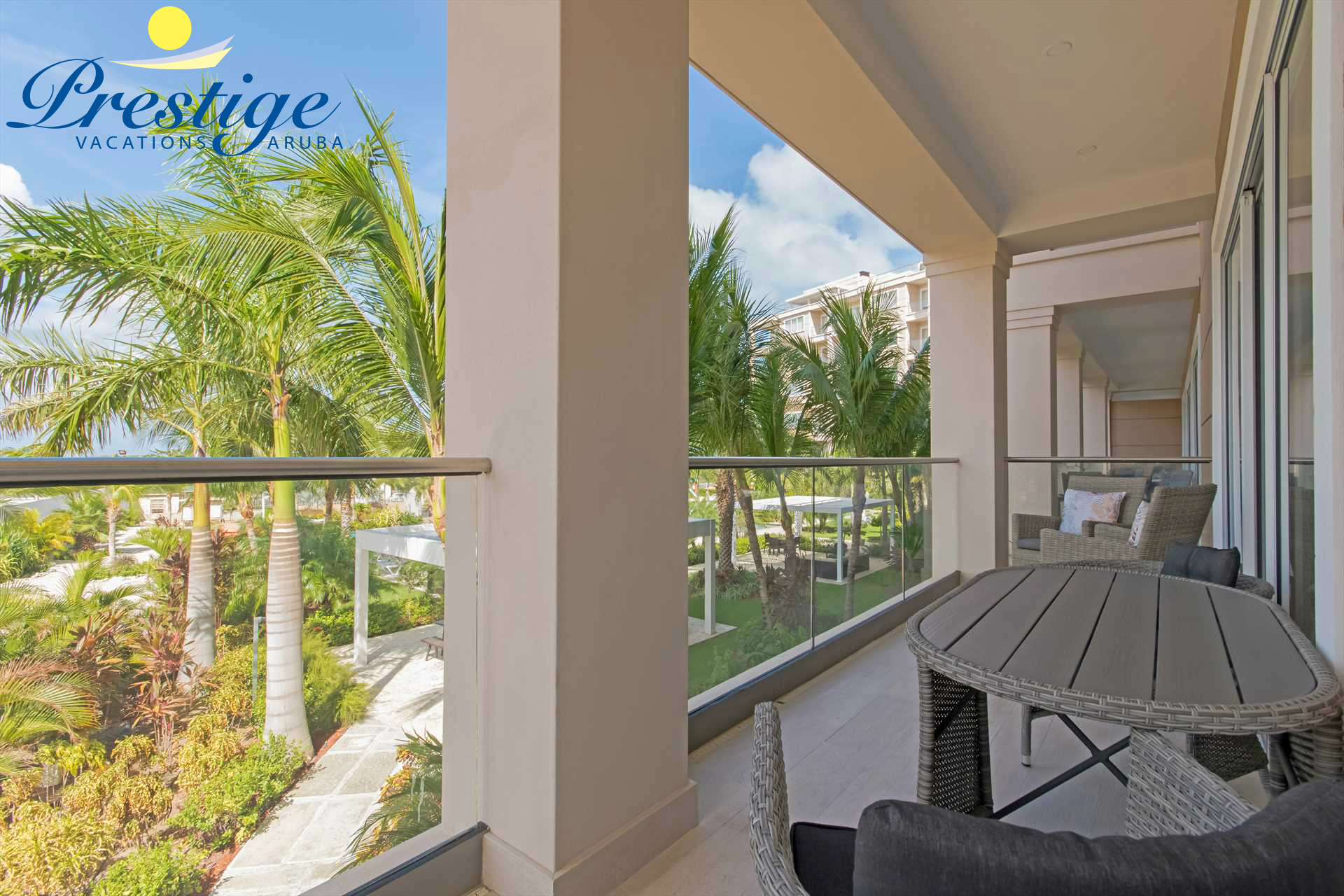 Enjoy the serenity and the tropical landscaping of the resort on your furnished balcony