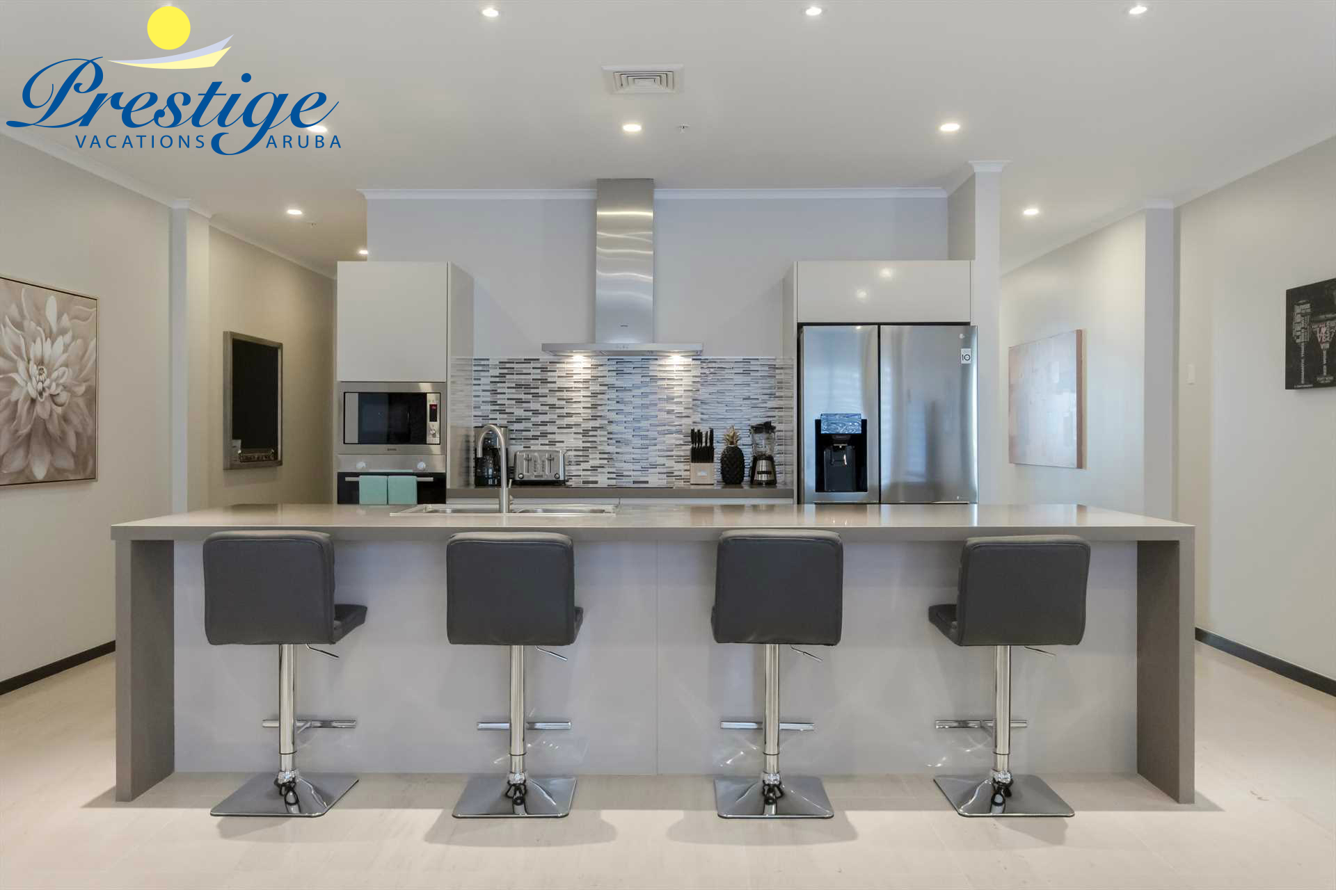 Full-sized fully equipped modern kitchen with 4-bar stools