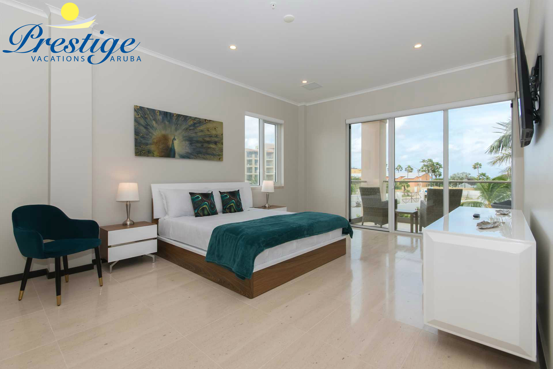 The master bedroom with a king-size bed, a TV and access to the balcony