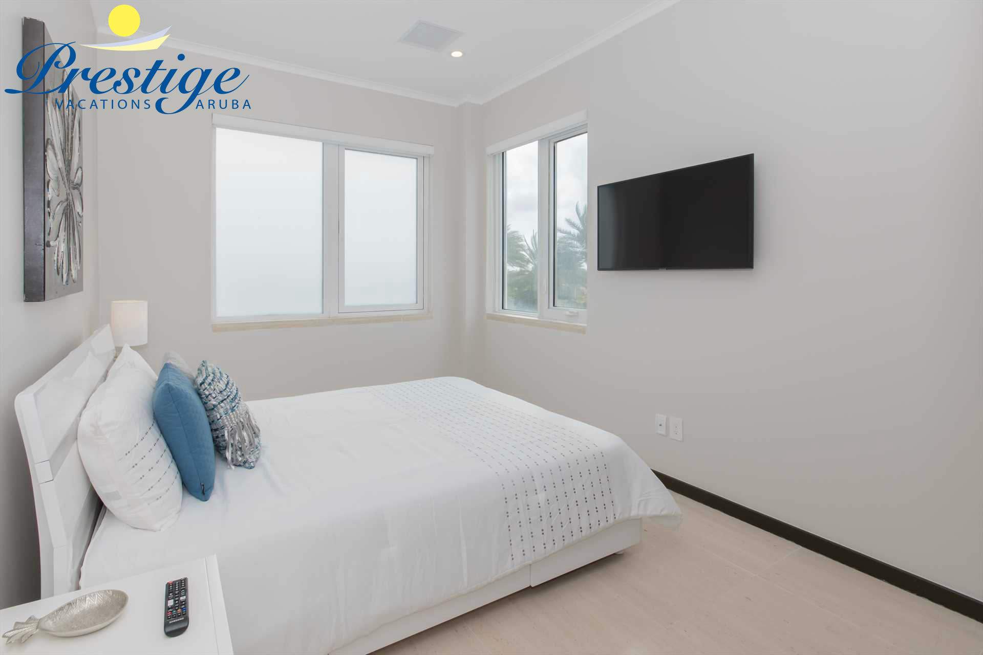 Second bedroom with a queen-size bed and TV