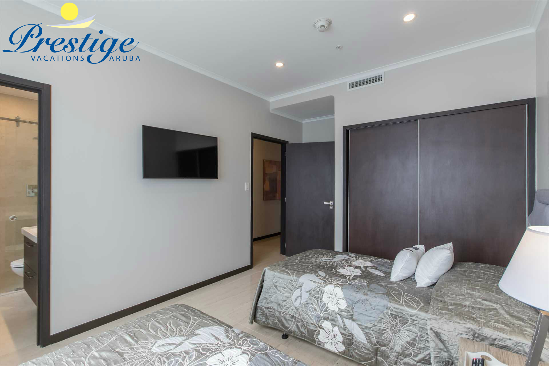 The third bedroom with a TV, built-in closet and an en-suite bathroom