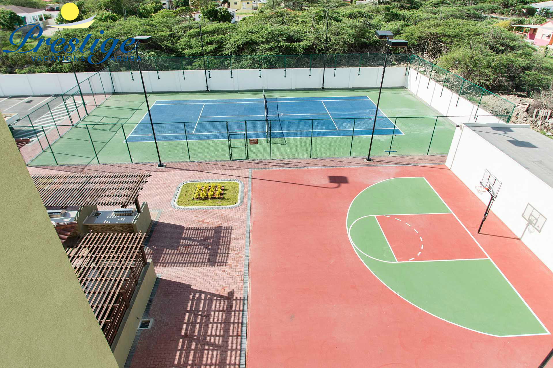 Hard surface tennis court and half basketball court available too!