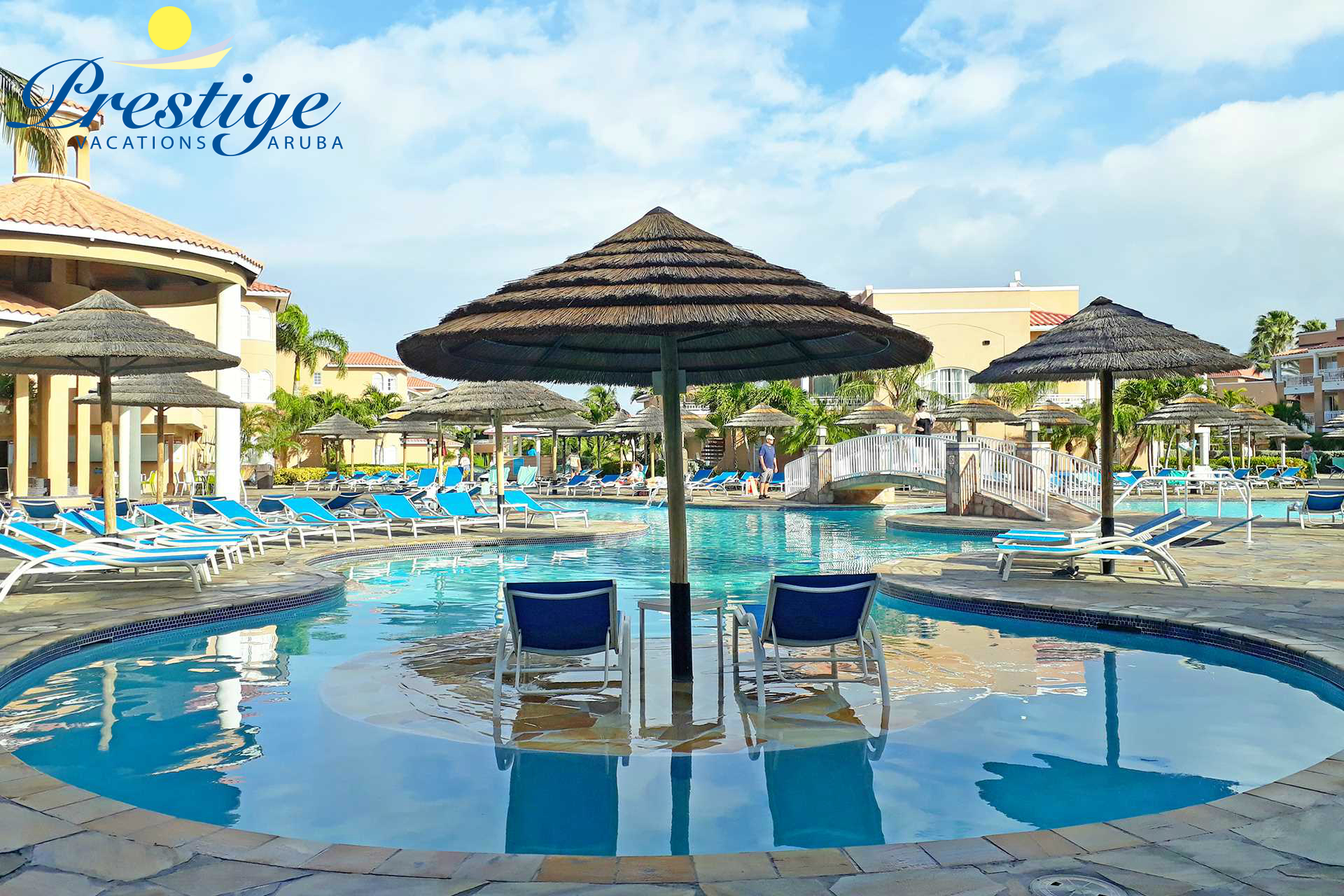 Divi resort main swimming pool area with palapas and lounge chairs for use by all guest