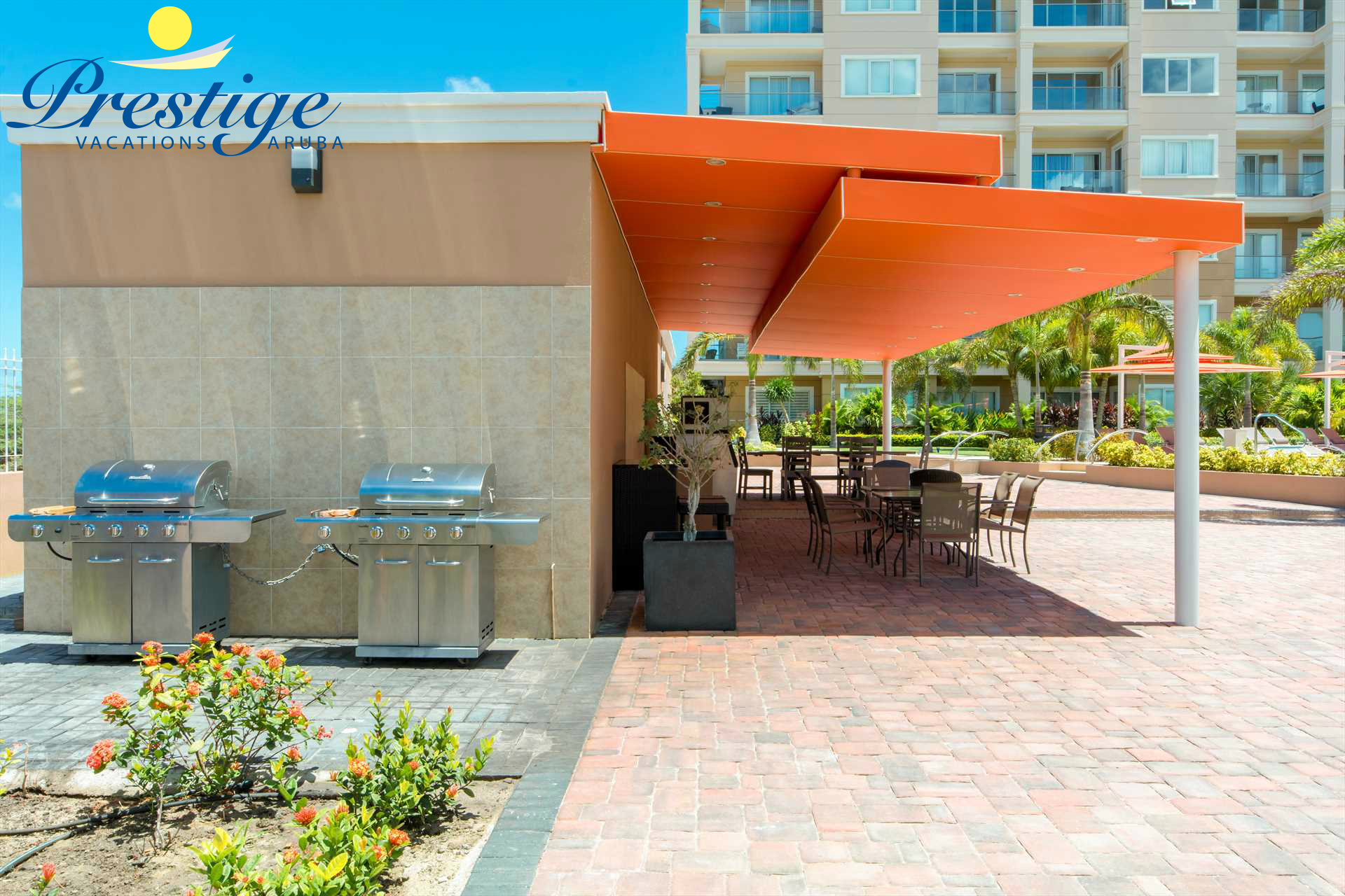The communal alfresco dining space with 2 BBQ-grills at the LeVent Aruba Resort