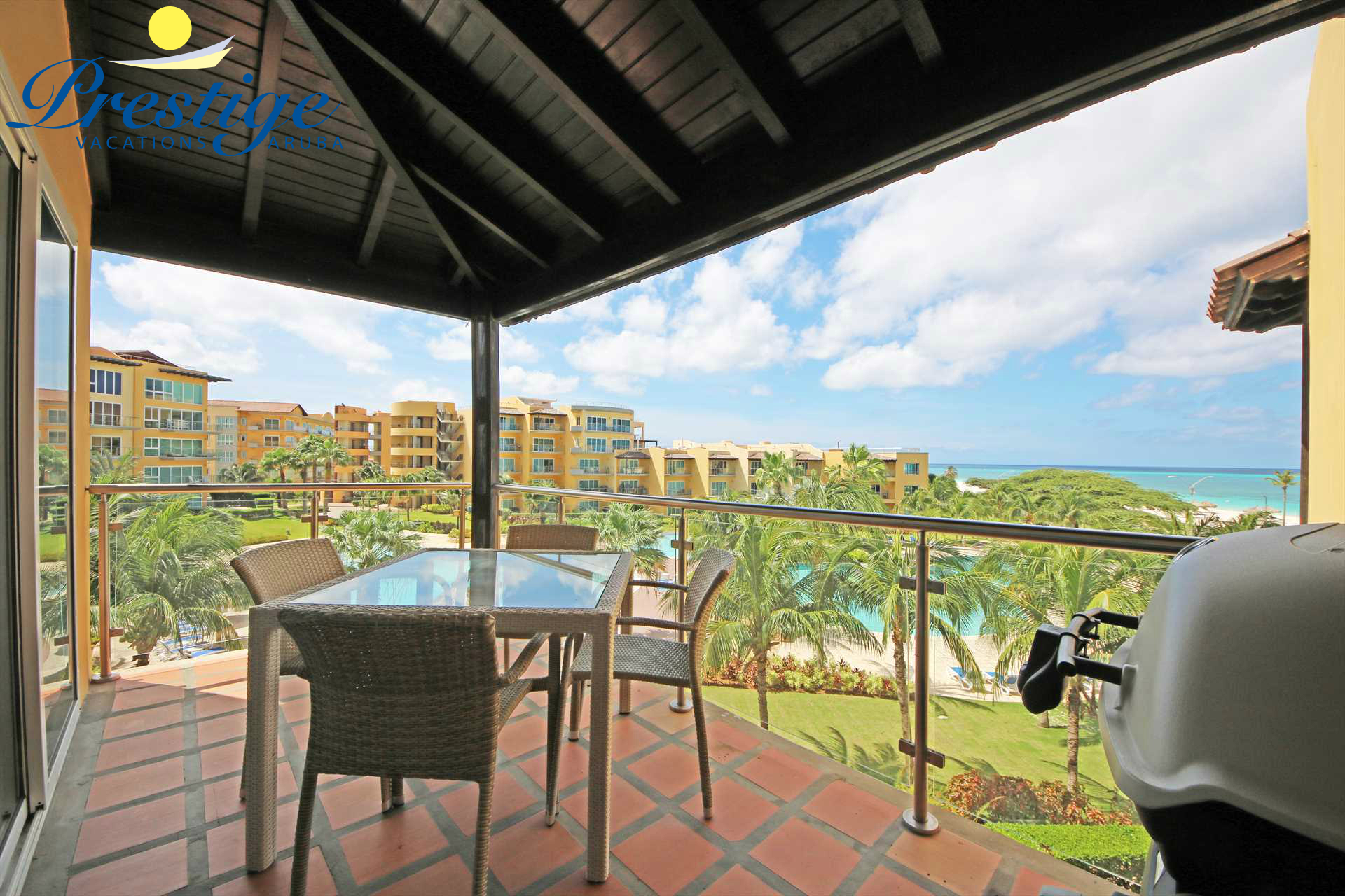 Your ocean and resort pool view from the living room balcony
