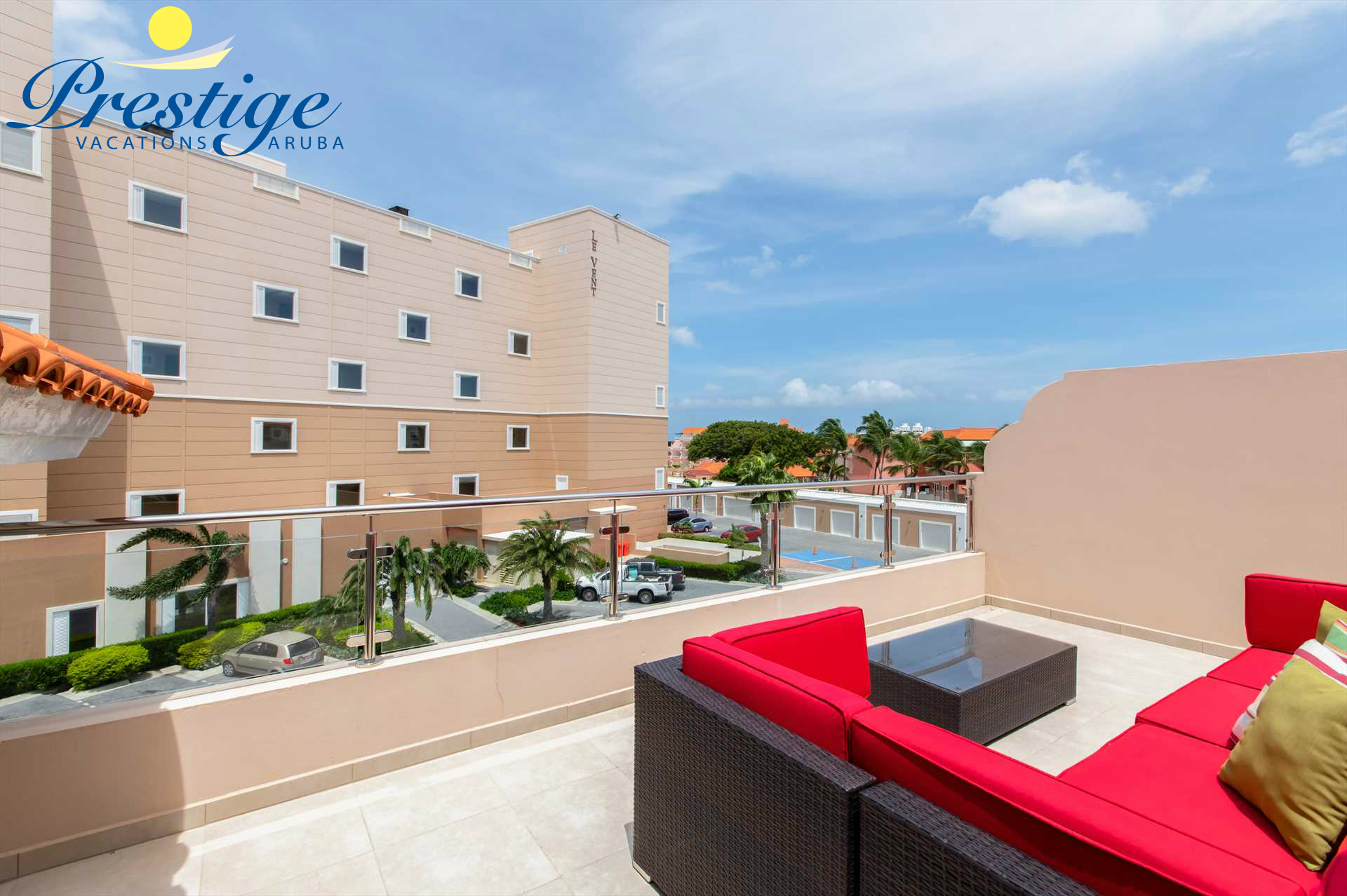 Private rooftop terrace with an outdoor seating area to enjoy Aruba's summer weather